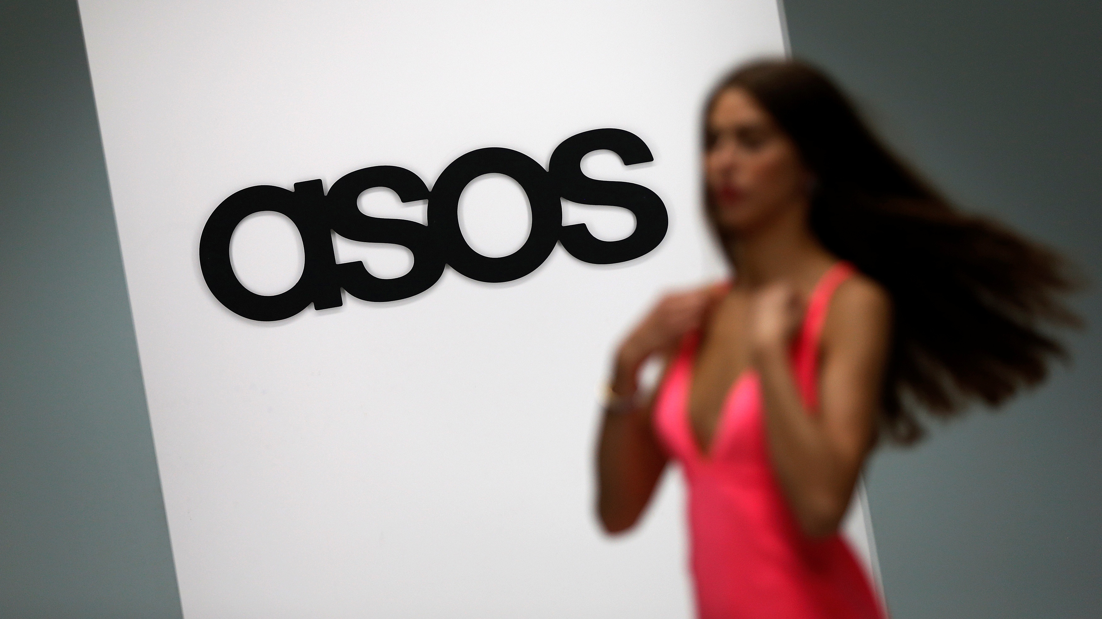 A model walks on an in-house catwalk at the ASOS headquarters in London April 1, 2014. REUTERS/Suzanne Plunkett/File Photo