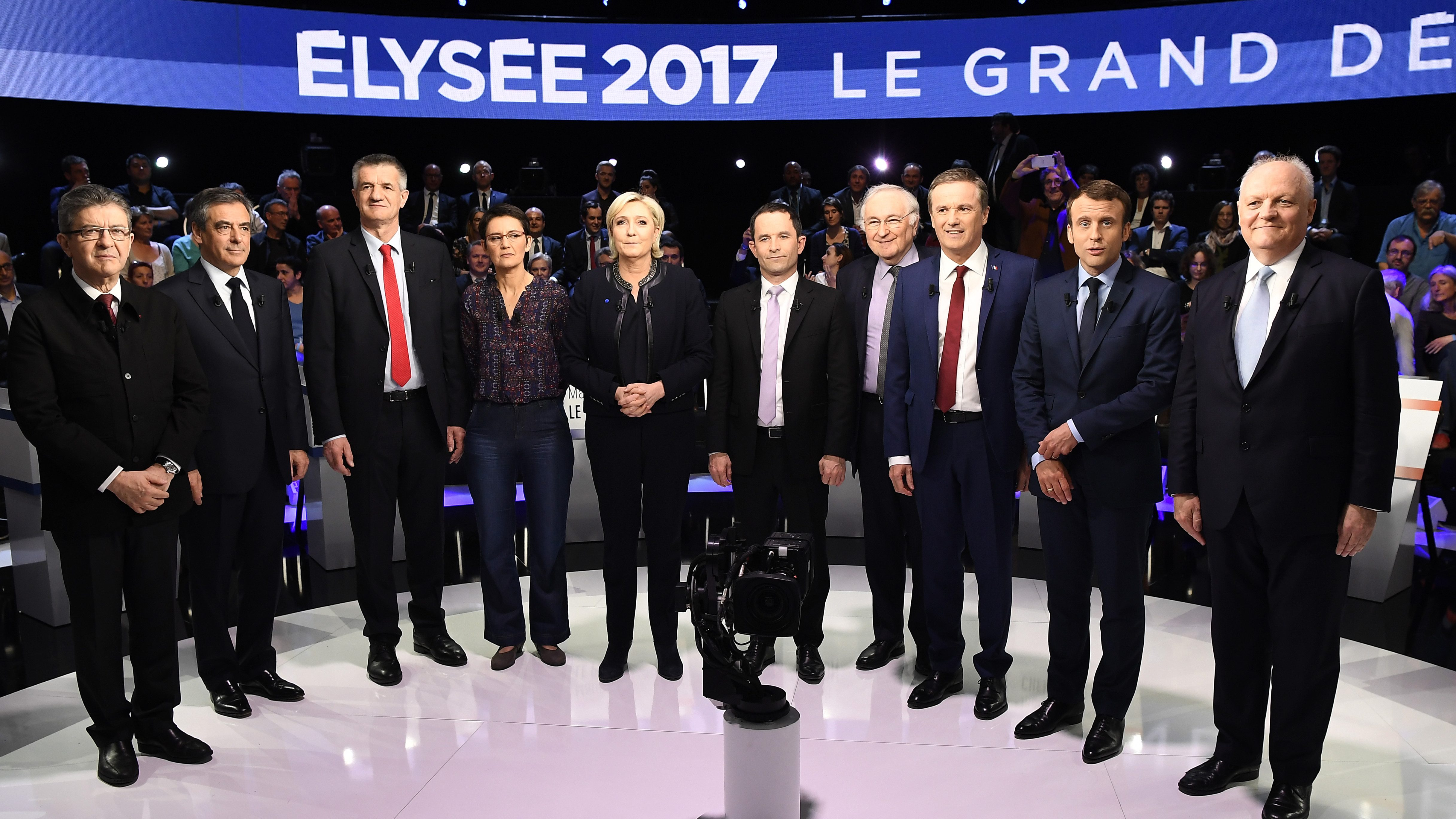 Candidates pose prior to a prime-time televised debate for the French 2017 presidential election in La Plaine Saint-Denis, near Paris