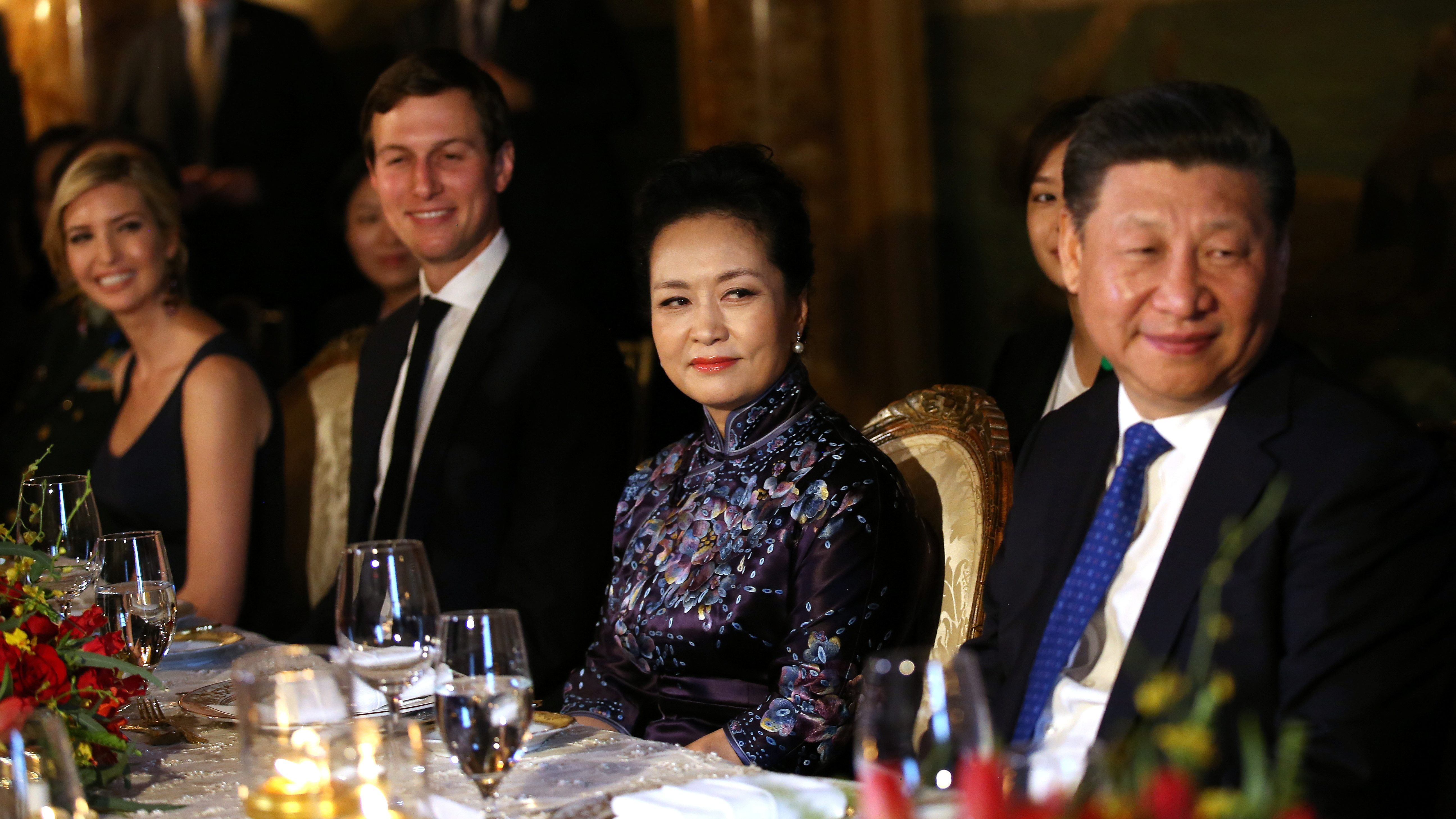 China's first lady Peng Liyuan looks at Chinese President Xi Jinping (R) as she sits next to Trump Senior Advisor Jared Kushner and Ivanka Trump (L), during a dinner at the start of a summit between U.S. President Donald Trump and Chinese President Xi at Trump's Mar-a-Lago estate in West Palm Beach, Florida, U.S. April 6, 2017.
