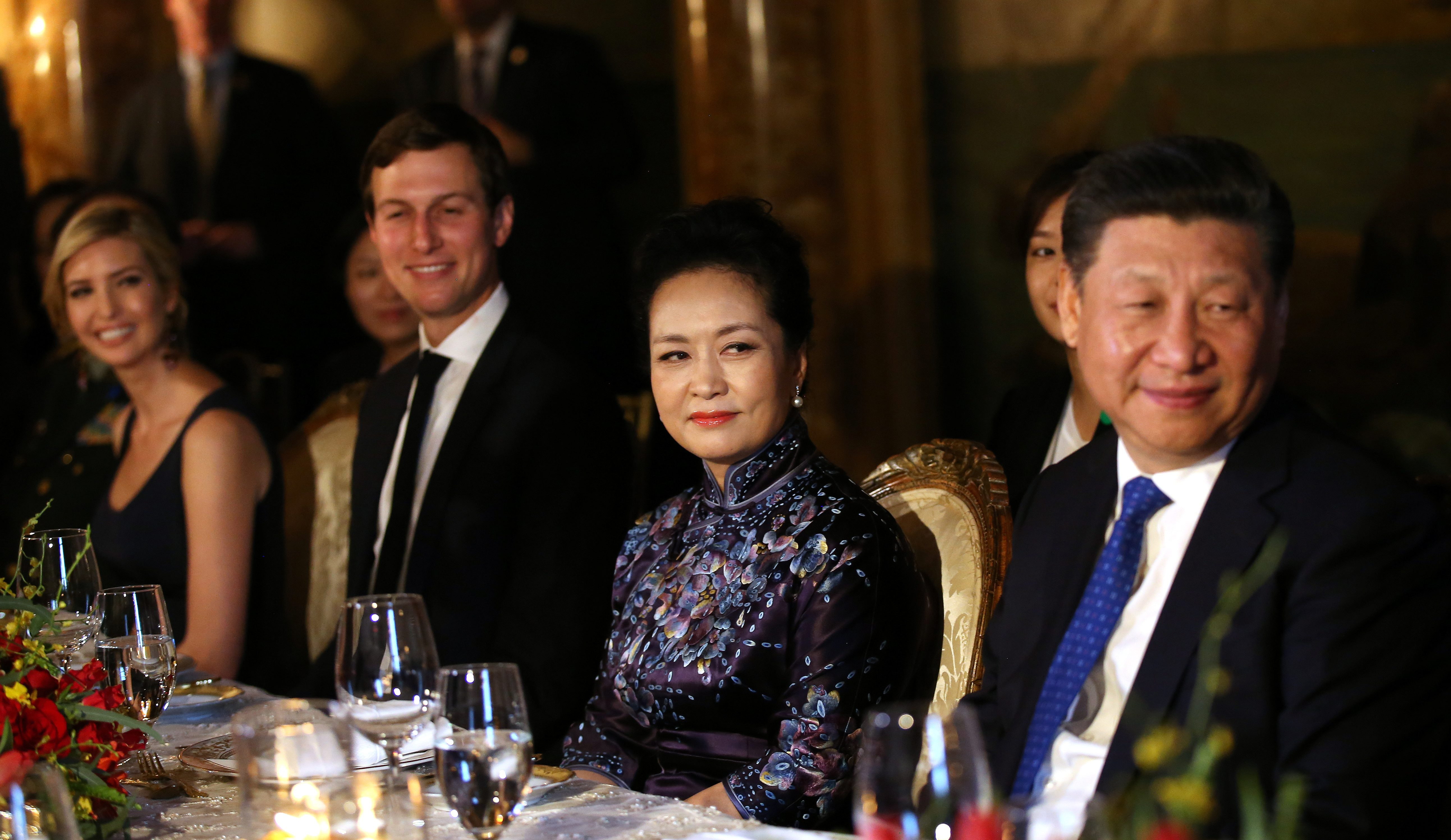 China's first lady Peng Liyuan looks at Chinese President Xi Jinping (R) as she sits next to Trump Senior Advisor Jared Kushner and Ivanka Trump (L), during a dinner at the start of a summit between U.S. President Donald Trump and Chinese President Xi at Trump's Mar-a-Lago estate in West Palm Beach, Florida, U.S. April 6, 2017. REUTERS/Carlos Barria - RTX34GUG