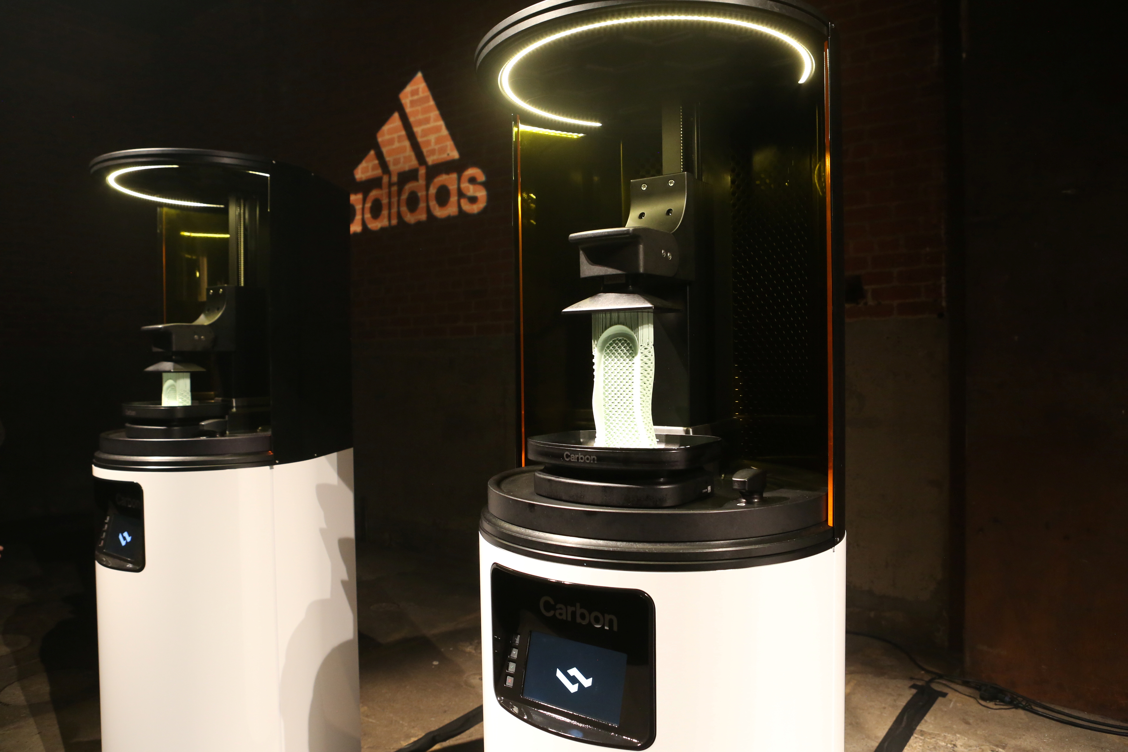 Carbon 3D printing machines are seen at an unveiling event for the new Adidas Futurecraft shoe in New York City, New York, U.S. April 6, 2017. REUTERS/Joe Penney - RTX34HDY