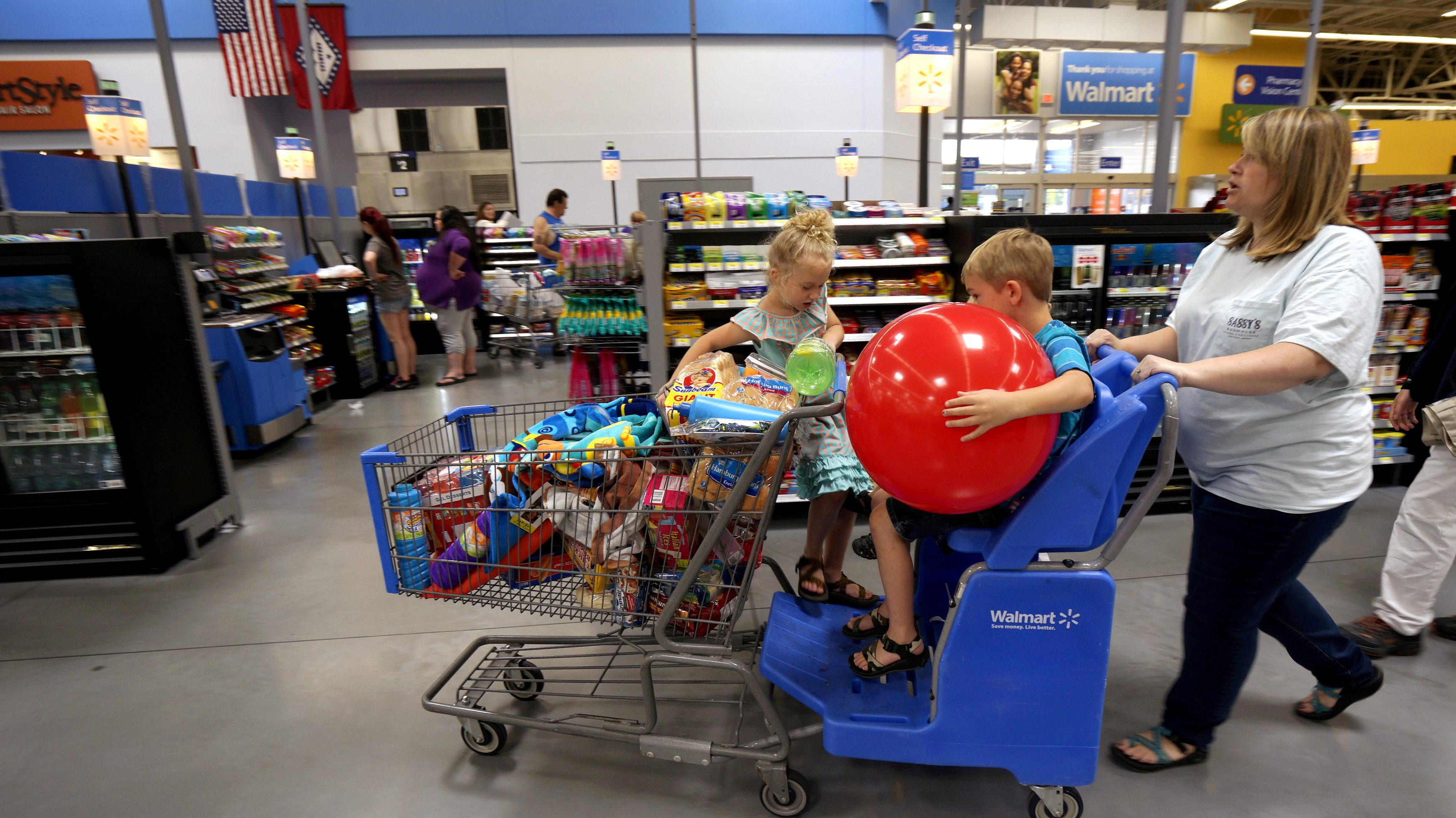 FILE PHOTO: A family shops at the Wal-Mart Supercenter in Springdale, Arkansas June 4, 2015.    REUTERS/Rick Wilking/File Photo                  GLOBAL BUSINESS WEEK AHEAD - SEARCH GLOBAL BUSINESS 10 APRIL FOR ALL IMAGES - RTX34VEF