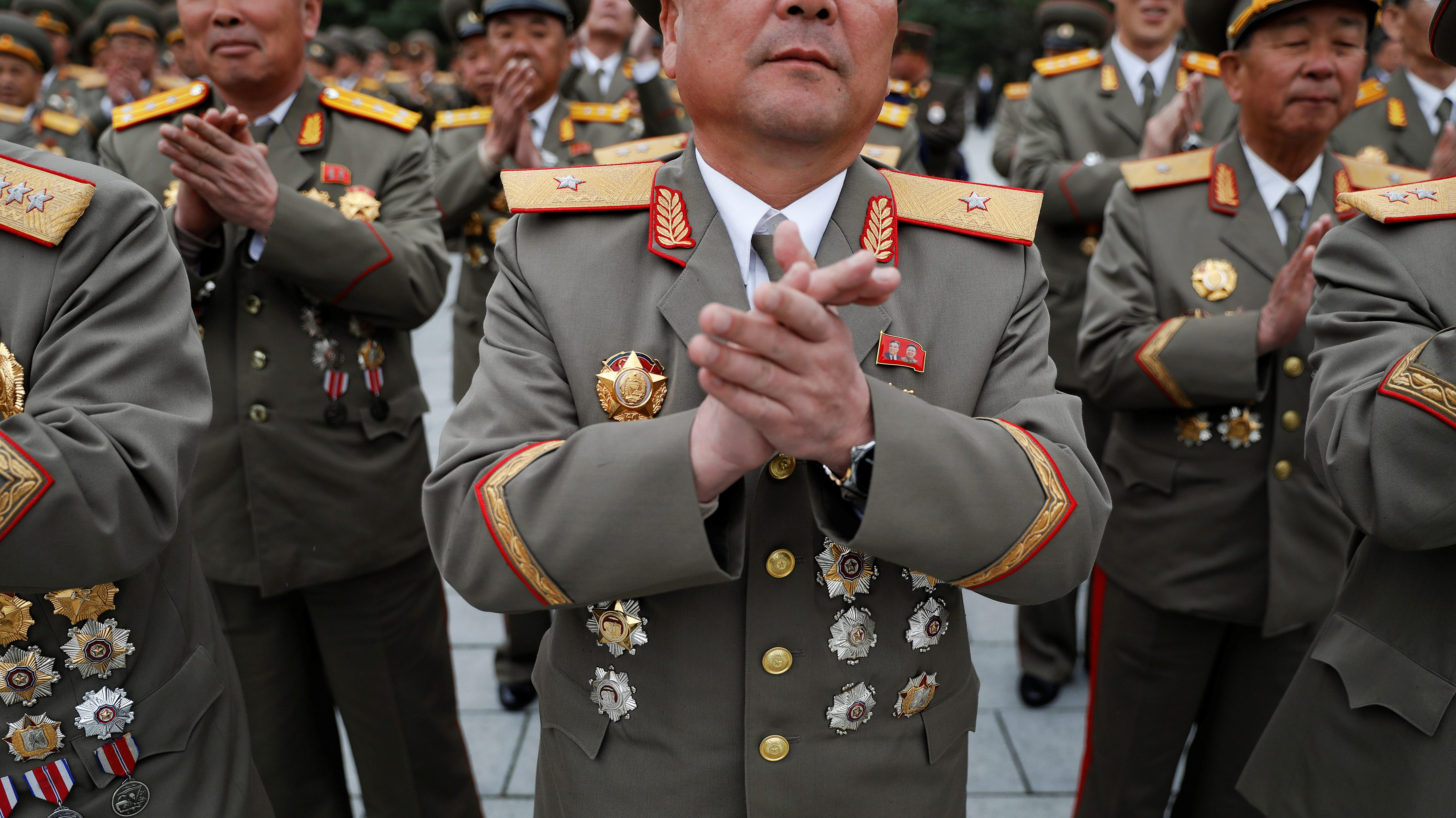 Military officers clap their hands as they visit the birthplace of North Korean founder Kim Il Sung, a day before the 105th anniversary of his birth, in Mangyongdae, just outside Pyongyang, North Korea April 14, 2017.