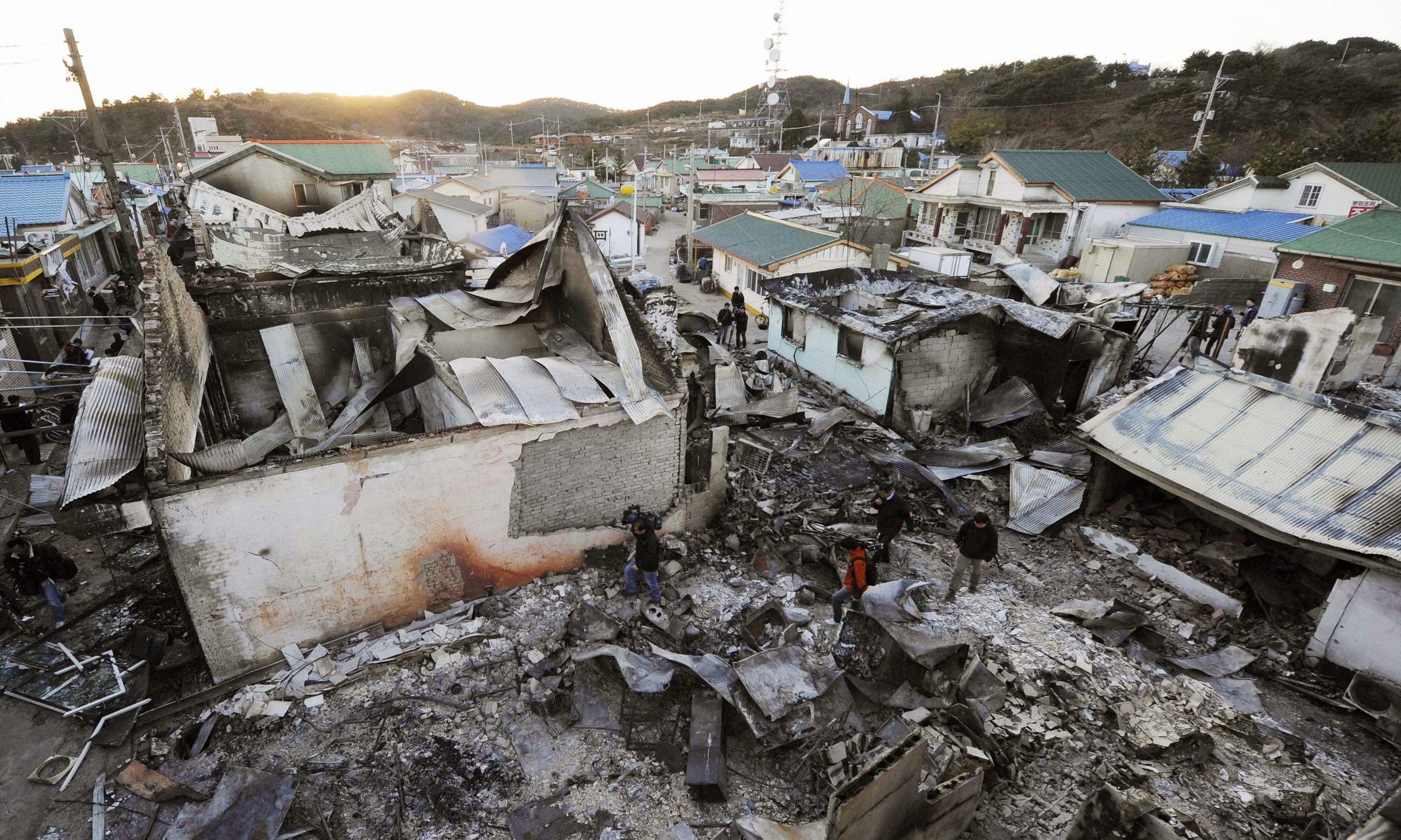 Houses destroyed by North Korean artillery shelling are pictured on Yeonpyeong island November 25, 2010. North Korea fired dozens of artillery shells at a South Korean island on Tuesday, killing two South Korean soldiers and two civilians and setting houses ablaze in the heaviest attack on its neighbor since the Korean War ended in 1953.