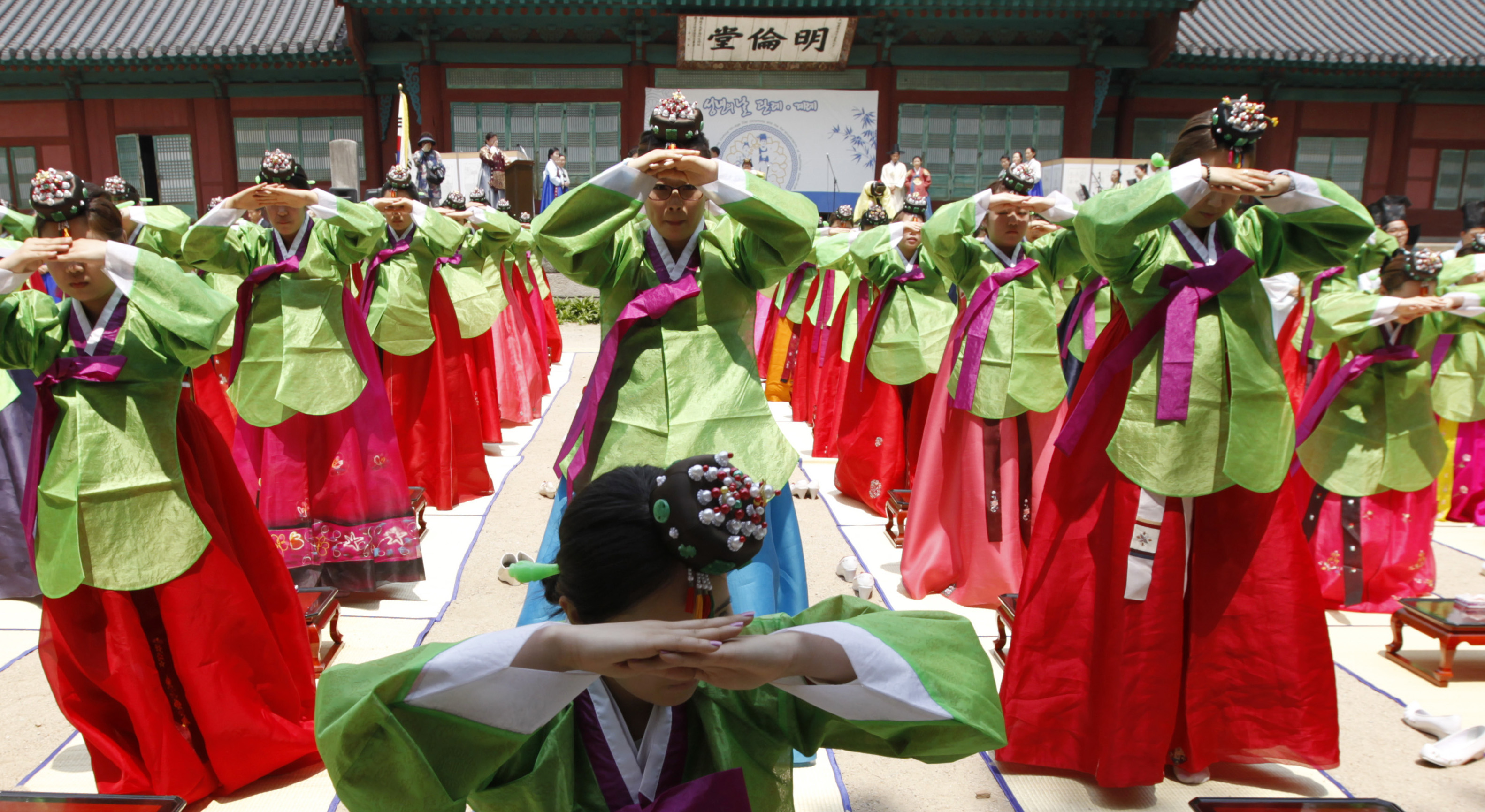 Korean women in traditional garb for maturity ritual into adulthood.