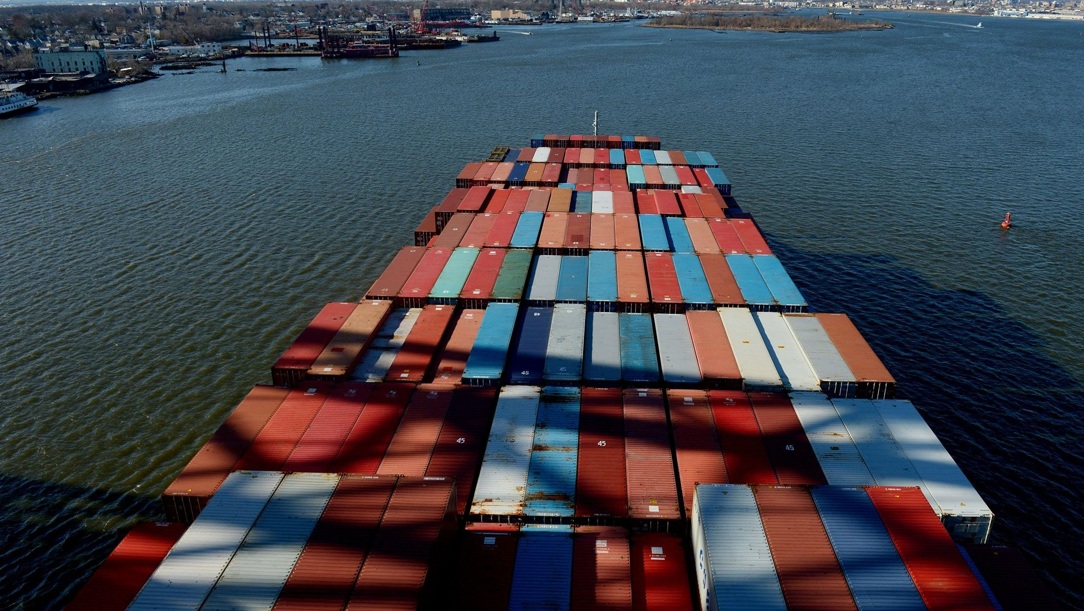 Dec. 28, 2012. A container ship makes its way into Newark Bay in Bayonne, New Jersey. A temporary deal between the International Longshoremen's Association and the United States Maritime Alliance was reached to avert a strike at East Coast ports