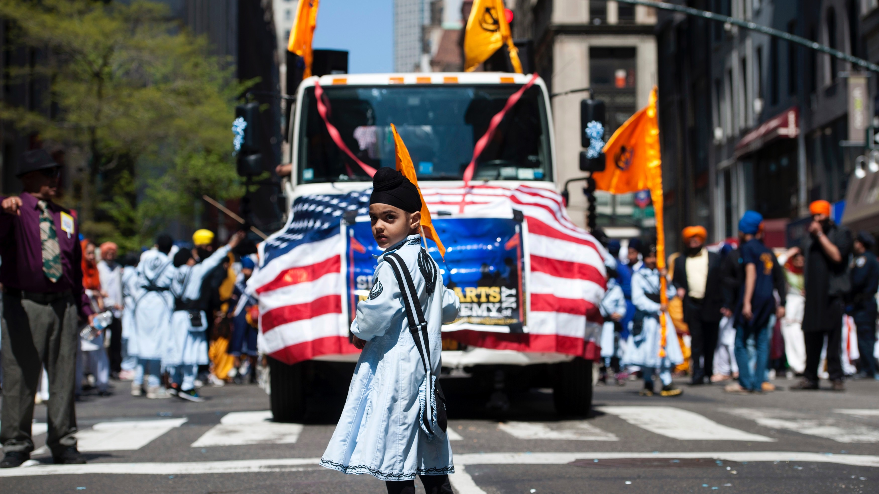 A Sikh boy marches in the annual Sikh Day Parade in New York, April 27, 2013.  REUTERS/Keith Bedford (UNITED STATES - Tags: RELIGION SOCIETY TPX IMAGES OF THE DAY) - RTXZ1YK
