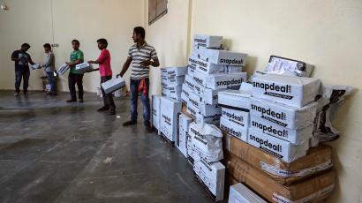 Employees of Snapdeal, an Indian online retailer, sort out delivery packages inside their company fulfilment centre in Mumbai
