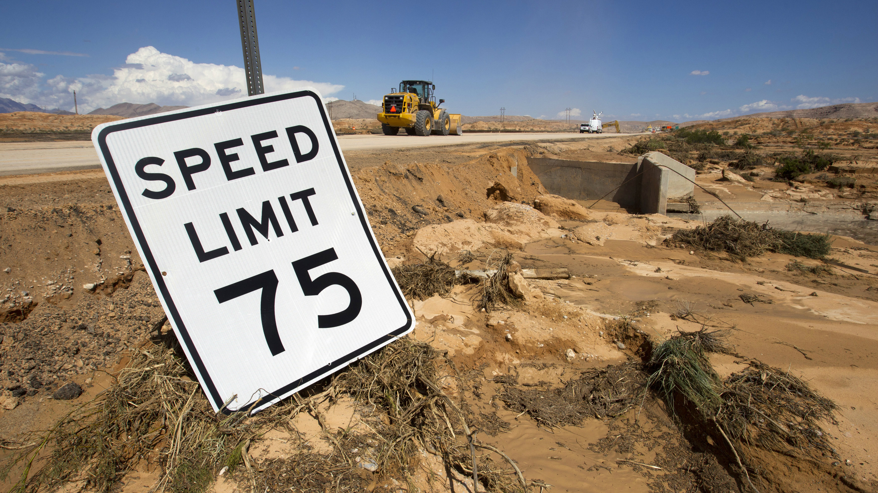 A speed limit sign is pictured by the side of Interstate 15 near Moapa, Nevada September 9, 2014. About 1 mile (1.6km) of freeway was severely damaged by the runoff from Monday's storm. The Nevada Department of Transportation expects to have two lanes open by the weekend, a spokesman said. REUTERS/Las Vegas Sun/Steve Marcus (UNITED STATES - Tags: TRANSPORT DISASTER ENVIRONMENT)