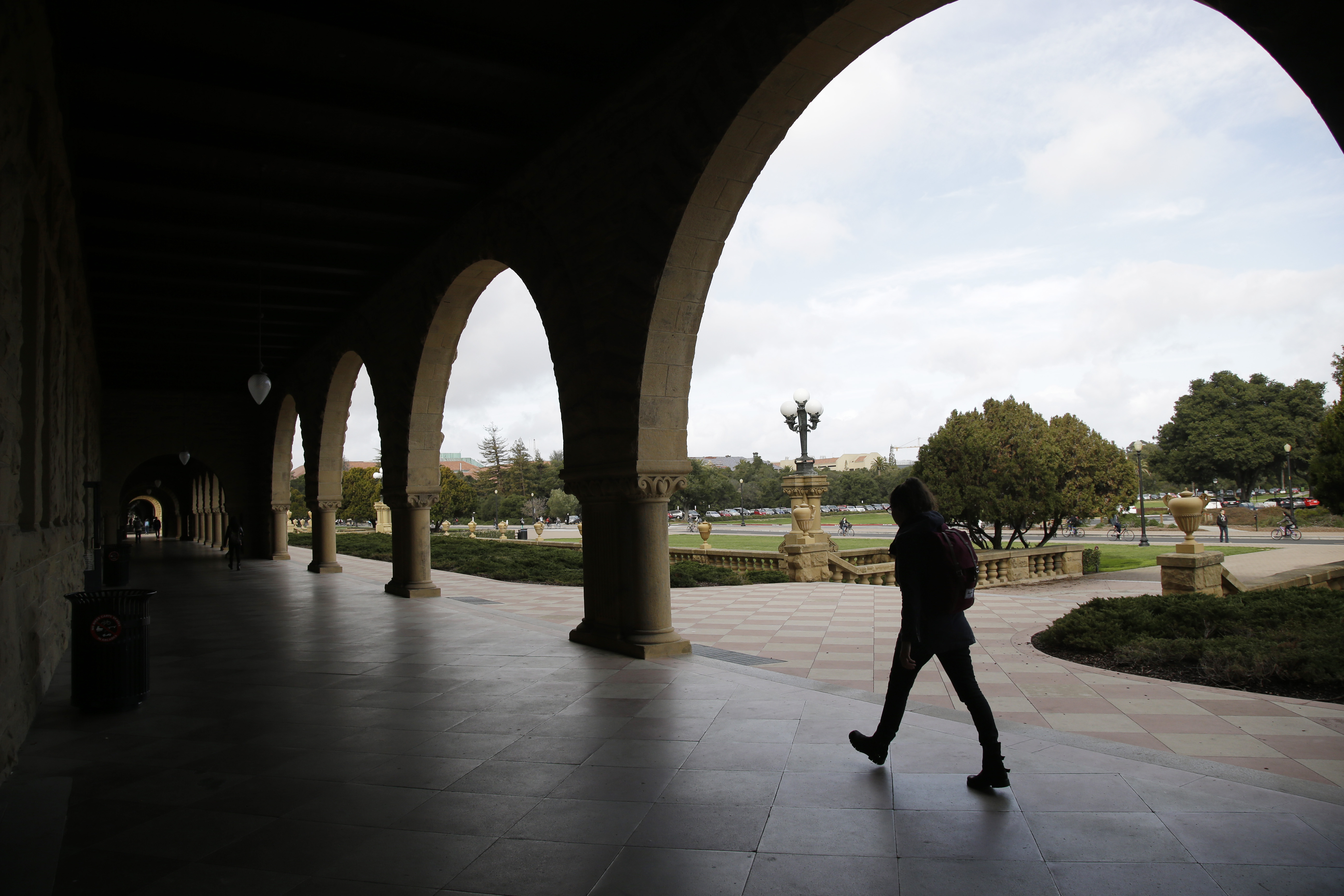 A student walks on campus at Stanford University Wednesday, Jan. 13, 2016, in Stanford, Calif.