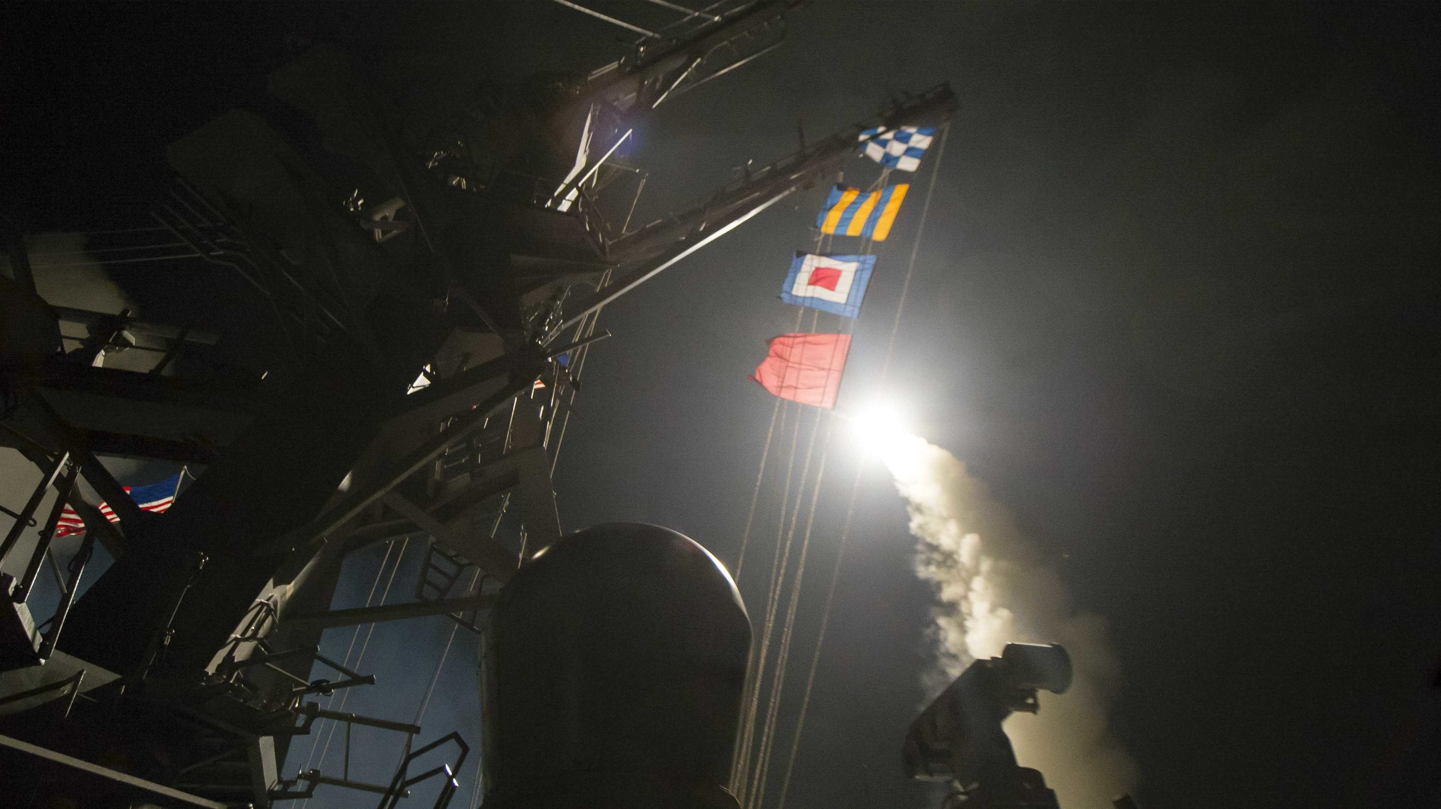 In this image provided by the U.S. Navy, the USS Ross (DDG 71) fires a tomahawk land attack missile Friday, April 7, 2017, from the Mediterranean Sea. The United States blasted a Syrian air base with a barrage of cruise missiles in fiery retaliation for this week's gruesome chemical weapons attack against civilians.
