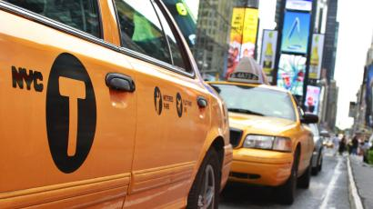 A New York City taxicab drives through Times Square in New York