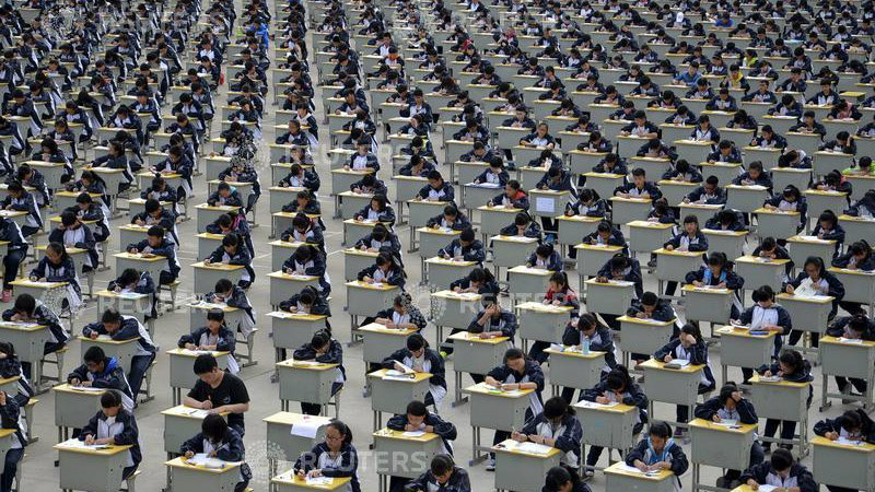 DATE IMPORTED:April 12, 2015Students take an examination on an open-air playground at a high school in Yichuan, Shaanxi province April 11, 2015. More than 1,700 freshmen students took part in the exam on Saturday, which was the first attempt by the school to take it in open-air. The school said the reasons was due to the insufficient indoor space and also that it could be a test of the students' organizing capacity, local media reported. Picture taken April 11, 2015. REUTERS/Stringer TPX IMAGES OF THE DAY
