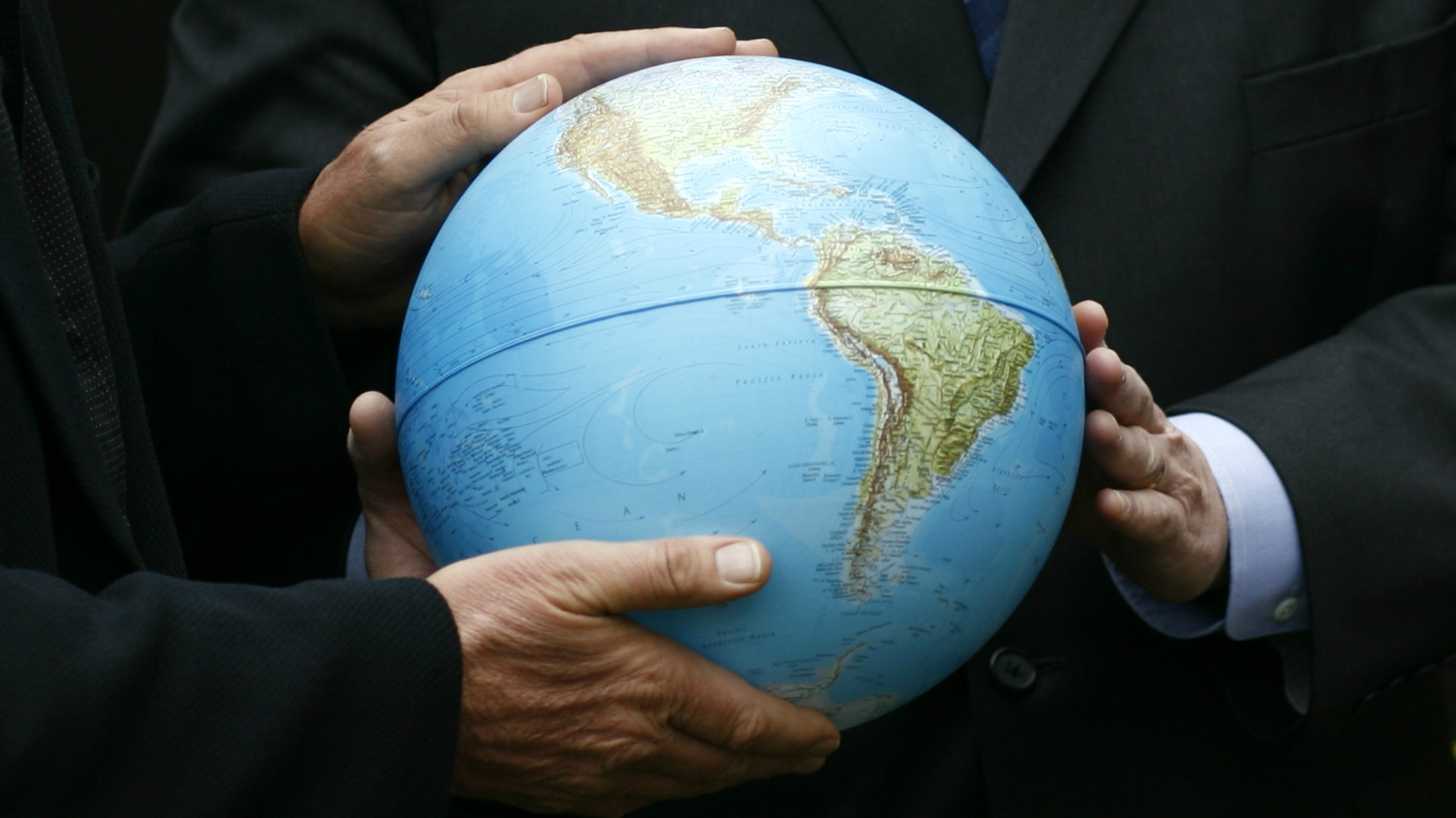 People holding a globe.