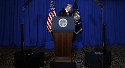 Addressing the President Donald Trump walks from the podium after speaking at Mar-a-Lago in Palm Beach, Fla., Thursday, April 6, 2017, after the U.S. fired a barrage of cruise missiles into Syria Thursday night in retaliation for this week's gruesome chemical weapons attack against civilians.