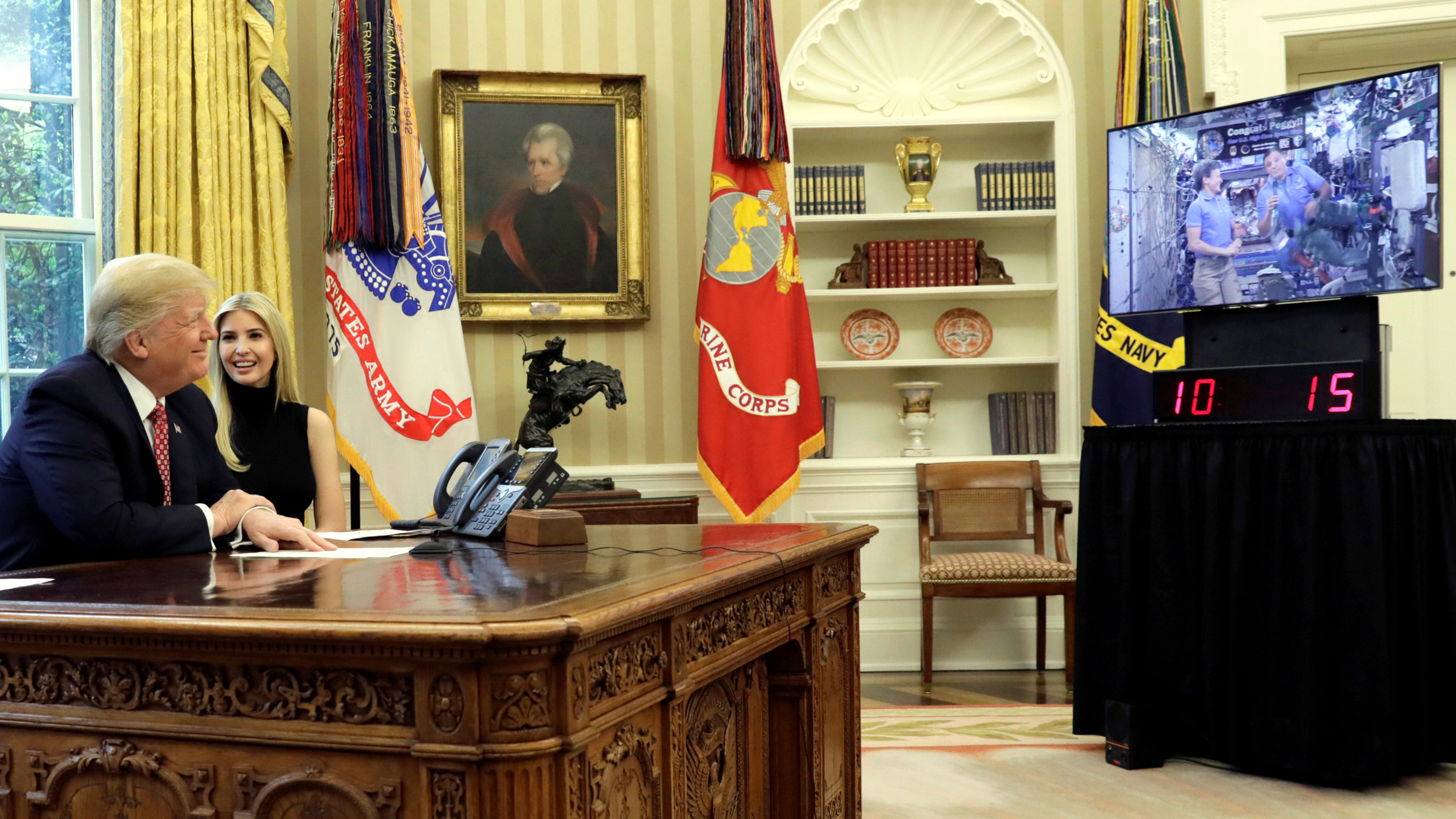 iU.S. President Donald Trump and his daughter Ivanka hold a video conference call with Commander Peggy Whitson and Flight Engineer Jack Fischer of NASA on the International Space Station from the Oval Office of the White House in Washington, U.S., April 24, 2017.