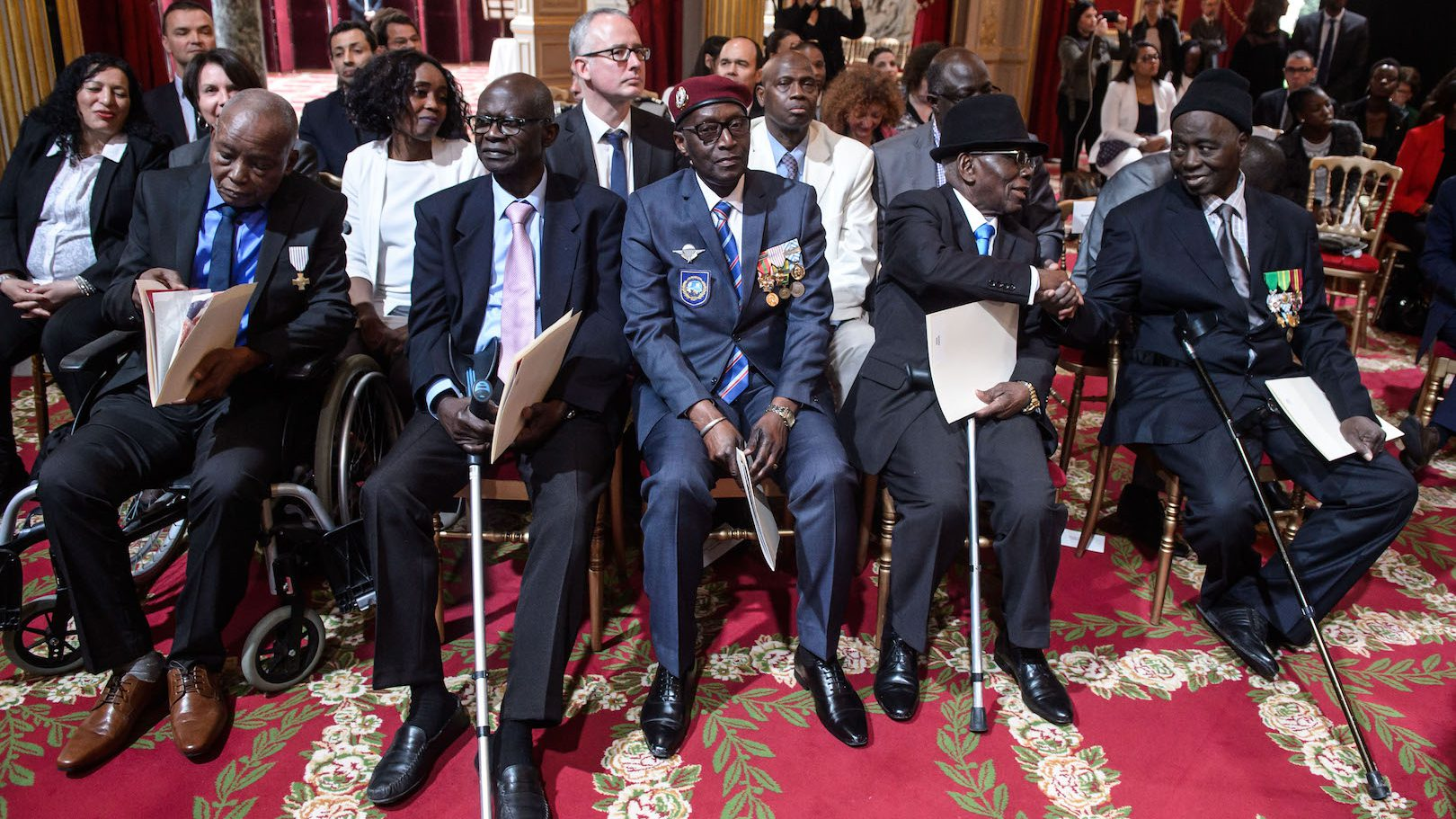epa05908822 Veterans wait during President Francois Hollande's speech (not pictured) as part of a ceremony to award French citizenship to former Senegalese riflemen veterans at the Elysee Palace in Paris, France, 15 April 2017.