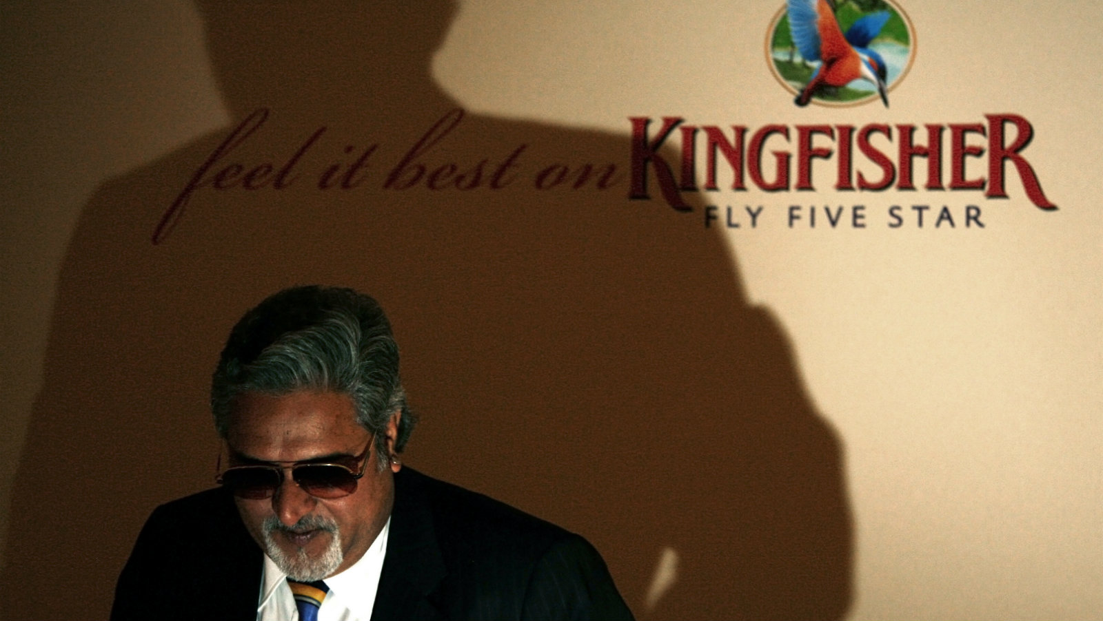 Kingfisher Airlines Chairman Vijay Mallya leaves after a news conference about the new Kingfisher Airlines service between London and Bangalore in southern India, in London September 4, 2008.