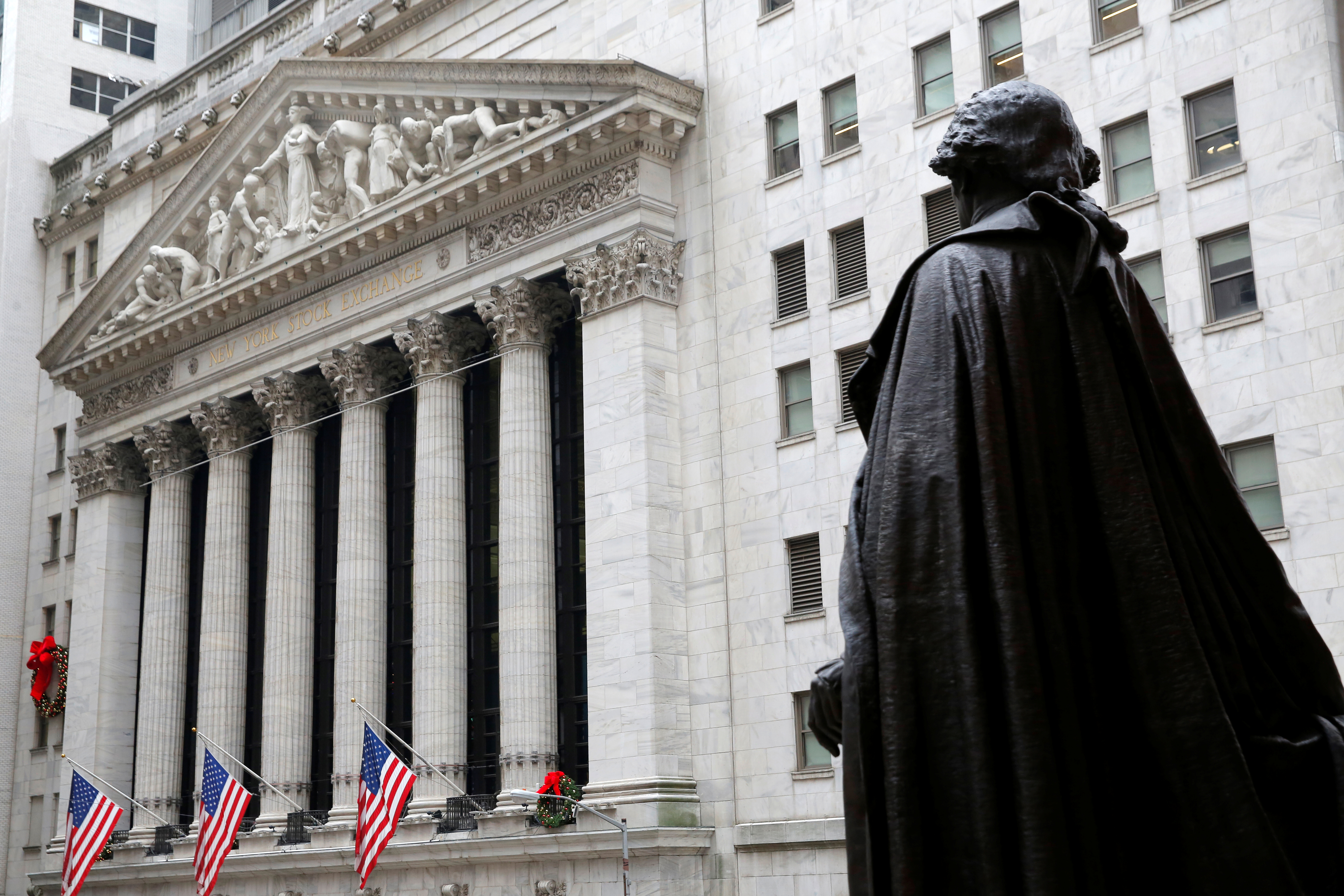 A statue of George Washington stands across from the New York Stock Exchange in Manhattan, New York City, U.S., December 21, 2016.