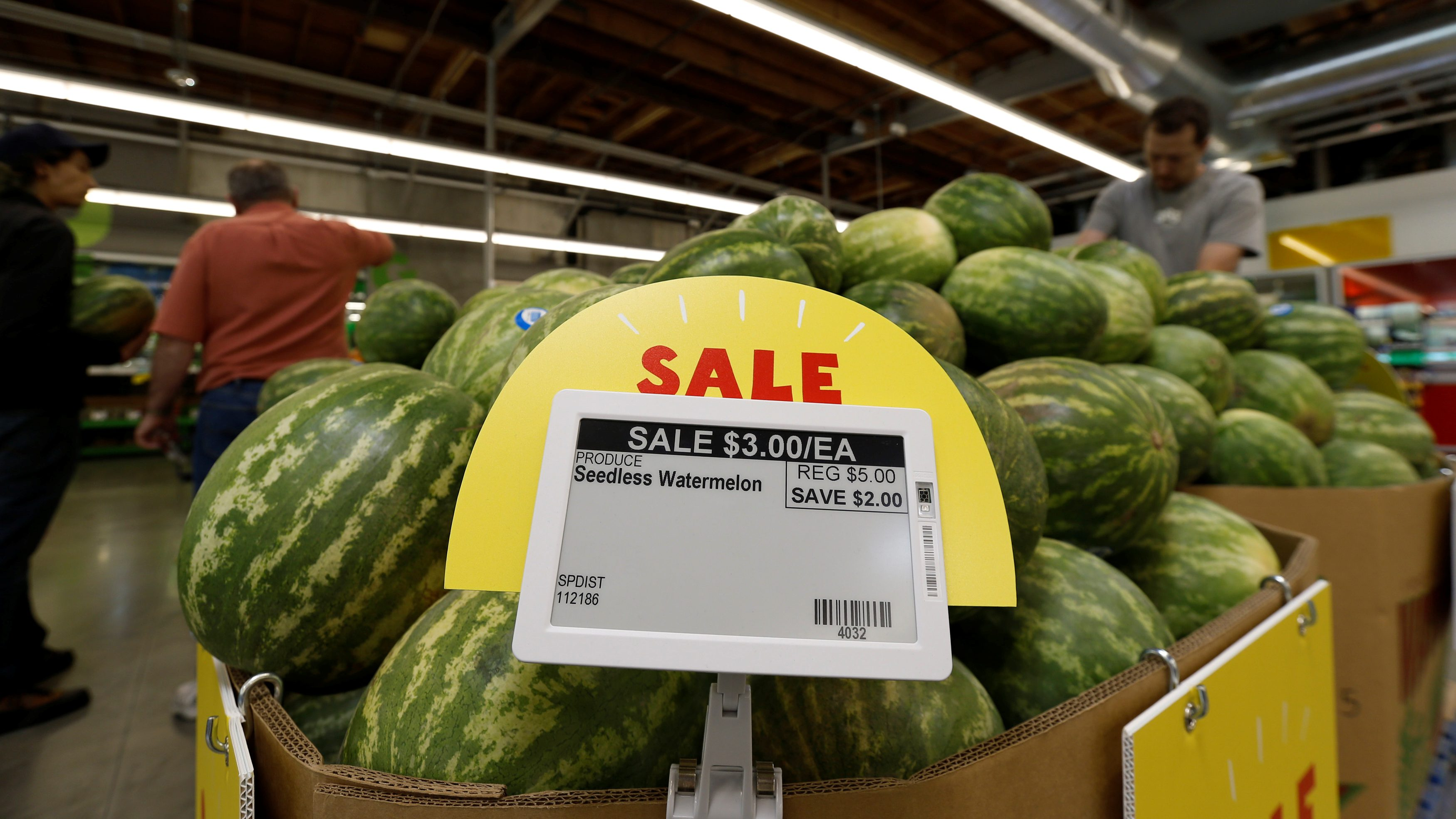 Watermelon prices are displayed on a digital price tag at a 365 by Whole Foods Market grocery store ahead of its opening day in Los Angeles, U.S., May 24, 2016. REUTERS/Mario Anzuoni - RTSFTZ3