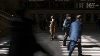 Woman stands still alone at Grand Central train Station