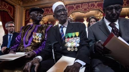 Yoro Diao, (C), 88, waits with other veterans during President Francois Hollande's speech (not pictured) as part of a ceremony to award French citizenship to former Senegalese riflemen veterans at the Elysee Palace in Paris, France, 15 April 2017.