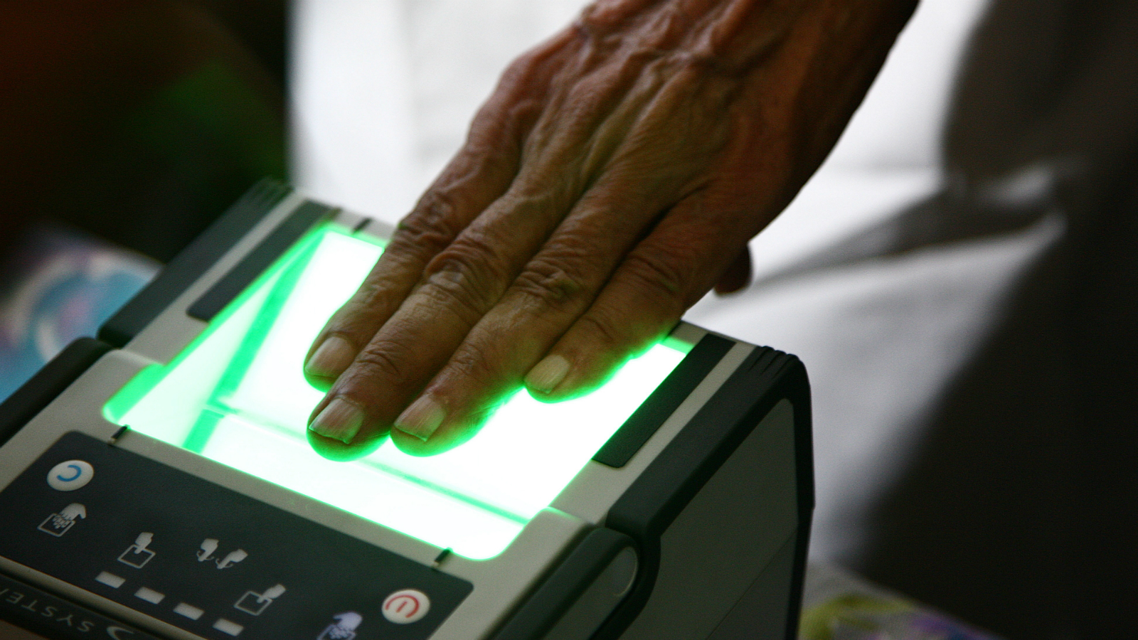 An Indian man scans his finger prints for enrollment of Aadhaar Number/ UID Card in Old Bhopal, Madhya Pradesh, India on 29 July 2011. The Unique Identification Authority of India (UIDAI) is an agency of the Government of India responsible for implementing the envisioned AADHAAR a unique identification project in India. The authority will aim at providing a unique number to all Indians and would provide a database of residents containing very simple data in biometrics. It is believed that Unique National IDs will help address the rigged state elections and widespread embezzlement that affects subsidies and poverty alleviation programs and addressing illegal immigration into India and terrorist threats is another goal of the program. Aadhar card to become the single source of identity verification card in India for many Sources. It provides the government with accirate and enough information on any individual residents of India. It also provides online authentication services for agencies or companies those who wish to validate an individual identity, news reports said. Aadhaar is a 12-digit unique number which the Unique Identification Authority of India (UIDAI) will issue for all residents in India.