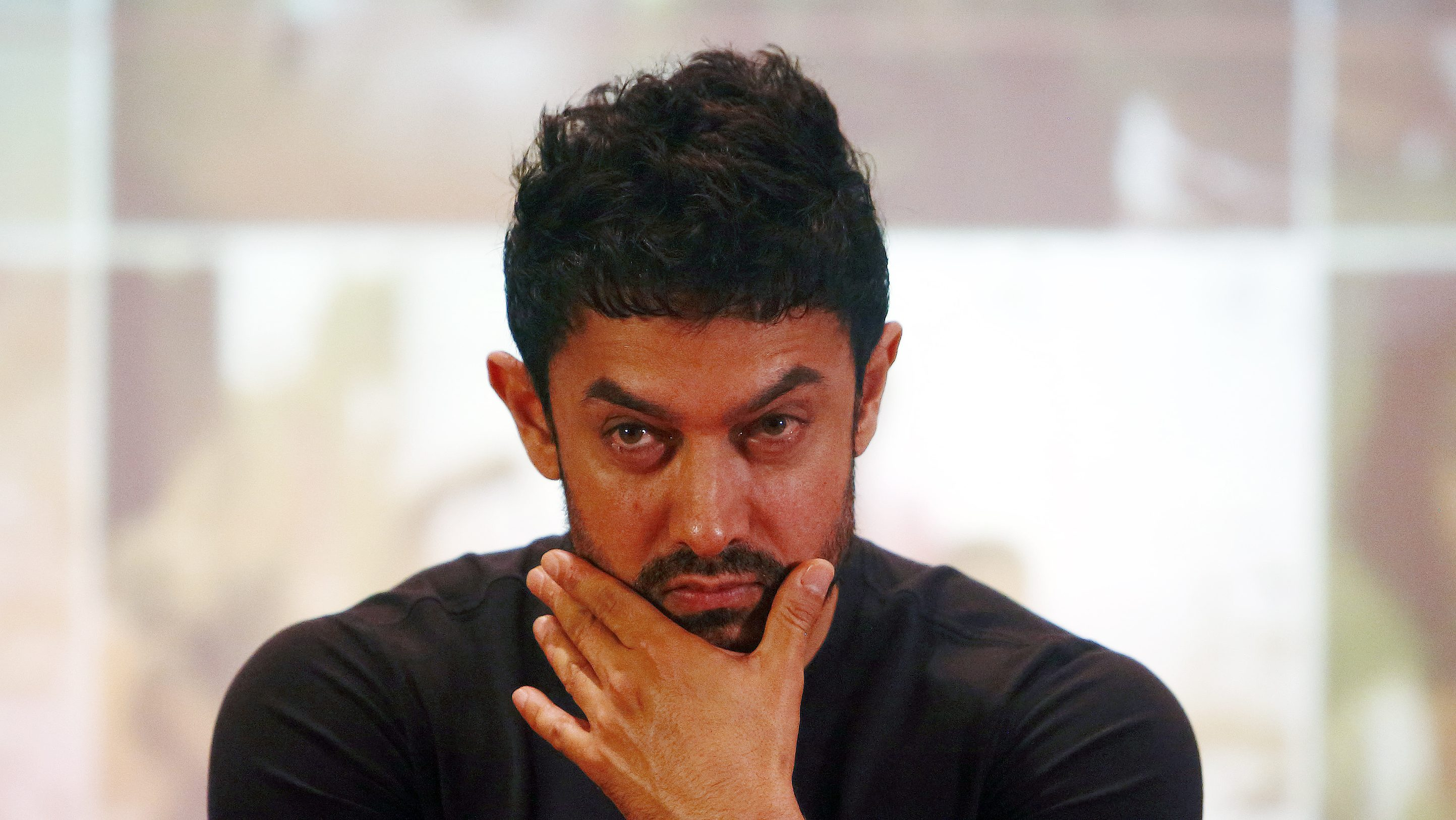 Bollywood actor Aamir Khan attends a news conference after an event to launch him as a United Nations Children's Fund (UNICEF) Regional Goodwill Ambassador for south Asia, in Kathmandu October 9, 2014. REUTERS/Navesh Chitrakar (NEPAL - Tags: ENTERTAINMENT POLITICS SOCIETY) - RTR49HYR