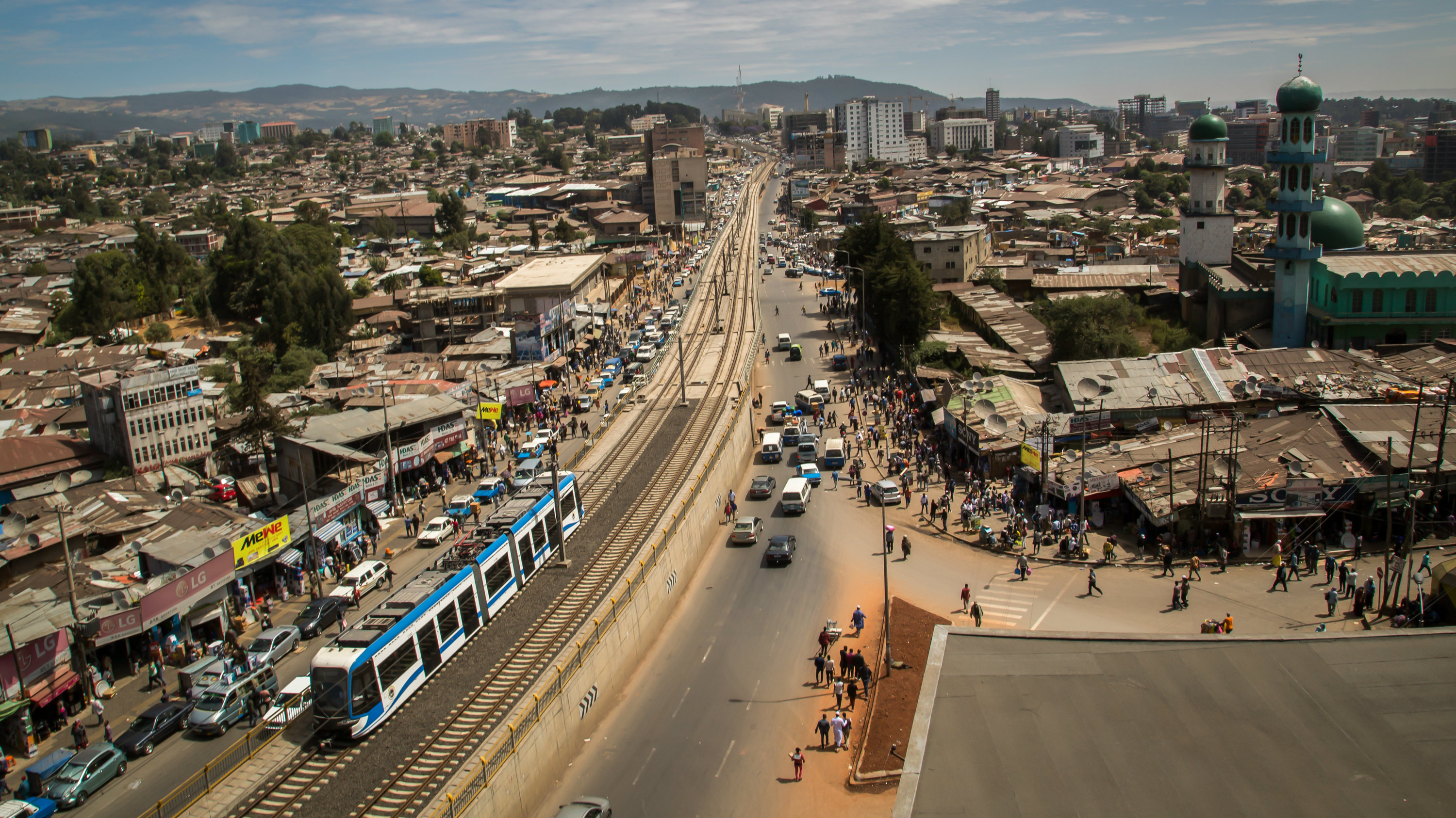 This image is released on Friday, Dec. 2, 2016, as it is announced that the city of Addis Ababa is a winner of the C40 Awards 2016 for its efforts to tackle climate change, in the Transportation Category. The Addis Ababa Light Rail Transit (LRT), the first of its kind in Sub-Saharan Africa, is changing the face of public transport in a city where almost 60% of the population walks to their destination. The LRT transports 60,000 passengers per hour and is helping to cut the city's greenhouse gas emissions. An Addis Ababa Light Rail Tram passes through Ethiopia's largest business district Merakto on Friday Nov. 11, 2016. For full release on the awards and their recipients go to: http://www.apcontentservices.com/multimedia-newsroom/c40-awards-the-11-best-cities-for-addressing-climate-change