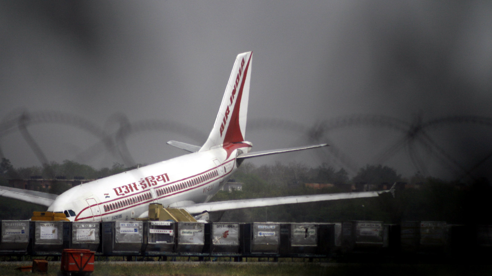 An Air India Airbus A310 is seen after it made an emergency landing at the international airport in New Delhi April 9, 2007. Two Air India planes made emergency landings on Monday at New Delhi's international airport, with the nose of one aircraft later hitting the ground as its front undercarriage collapsed while being towed away.