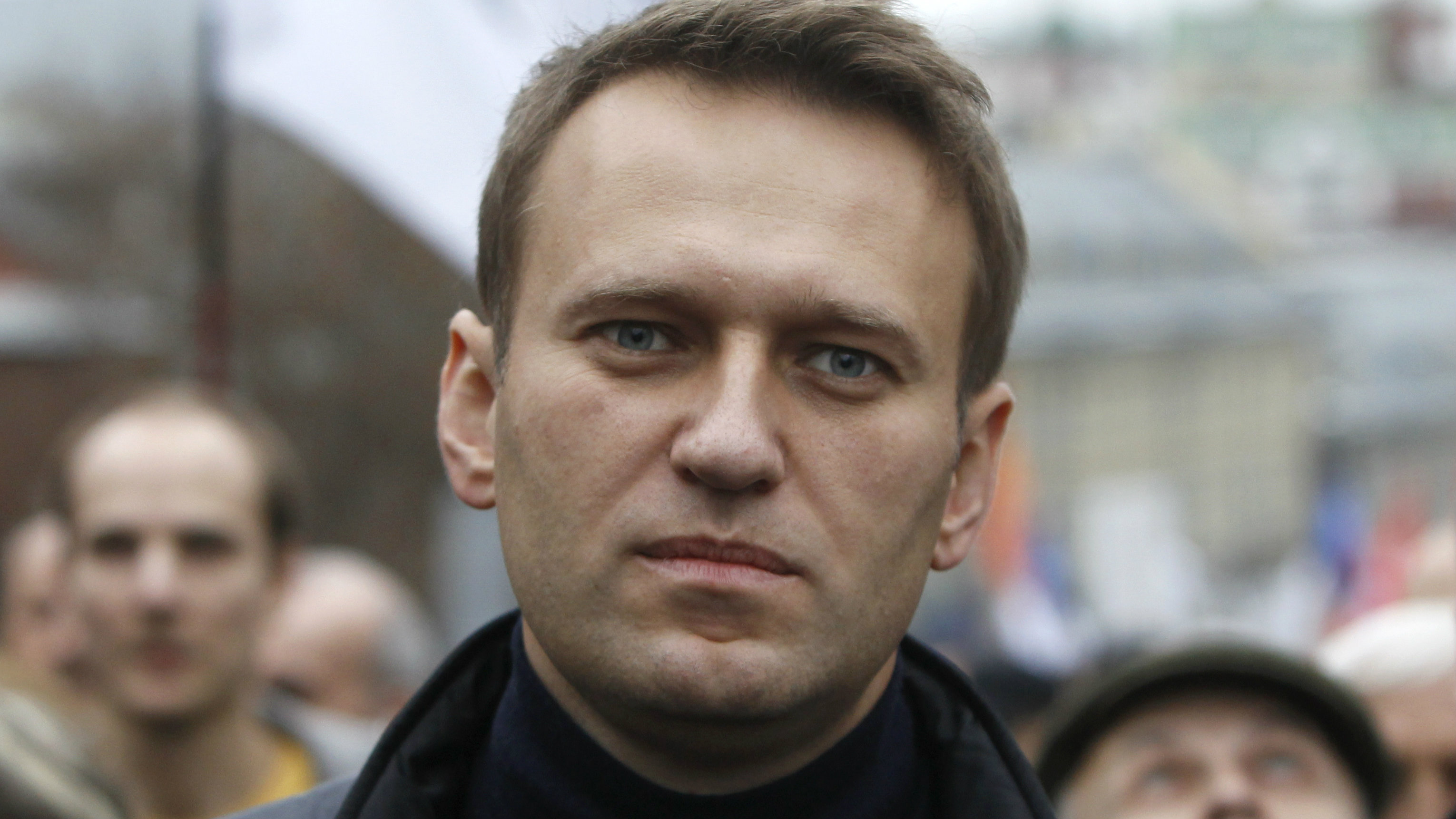 Russian opposition leader Alexei Navalny walks during an opposition rally in Moscow, October 27, 2013. Protesters demanded the release of political prisoners including anti-government activists detained in Moscow's Bolotnaya Square on May 6, 2012, the eve of President Vladimir Putin's inauguration. REUTERS/Maxim Shemetov (RUSSIA - Tags: CIVIL UNREST POLITICS CRIME LAW)