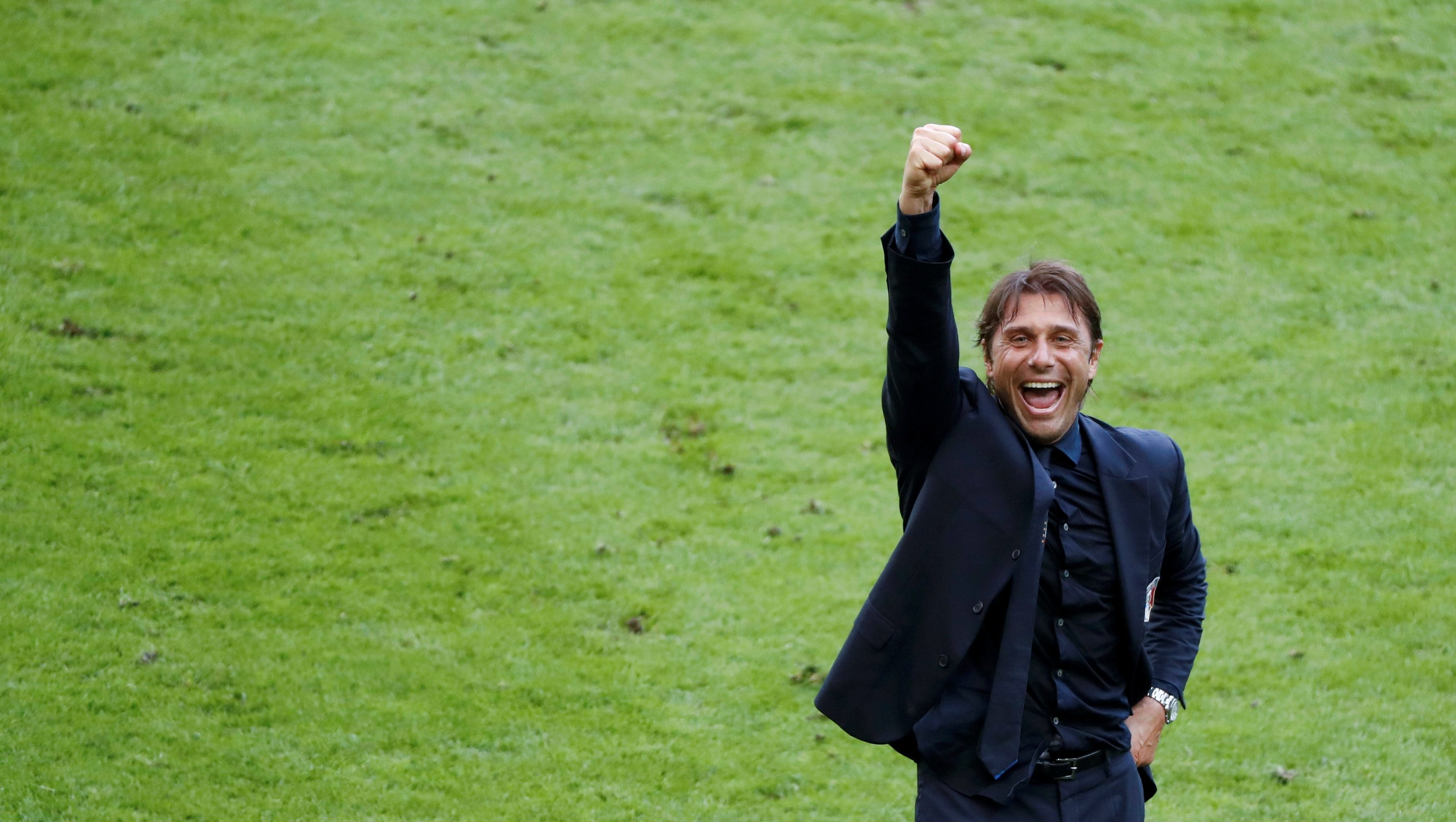 Italy's coach Antonio Conte celebrates after the match with France.