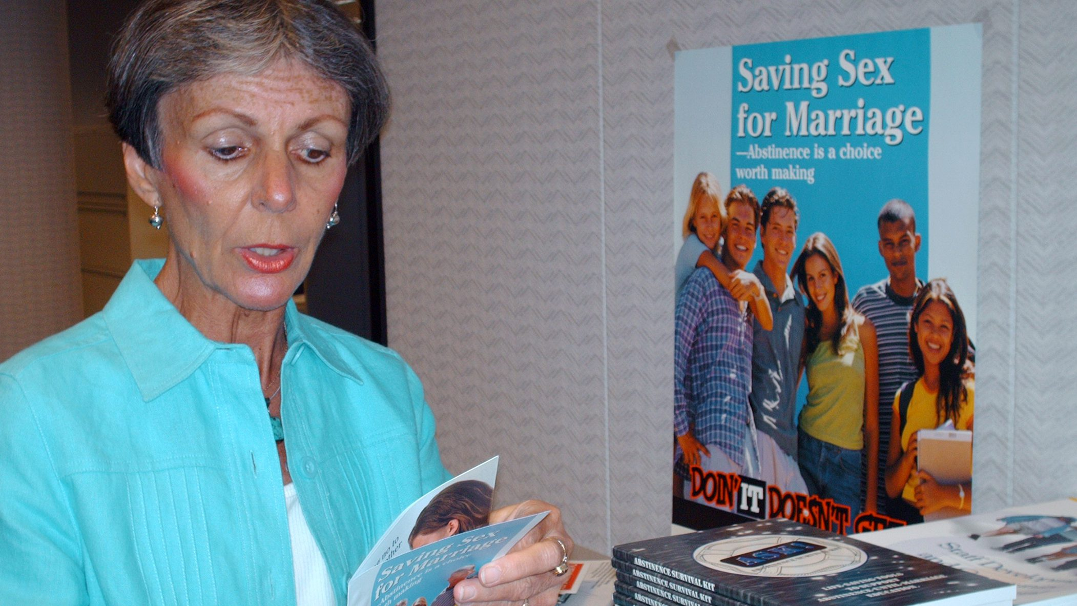 ** ADVANCE FOR SUNDAY JULY 2 ** Susan Stewart, director of the state health department's Alabama Abstinence-Until-Marriage Education Program, poses with some of her office's literature Thursday, June 29, 2006, in Montgomery, Ala. Alabama teachers walk a tightrope between educating their students and not straying beyond any of the state's abstinence-only guidelines found in the Alabama Code. Some officials say clearer guidelines and district wide curriculum are needed so teachers will know exactly what is expected of them and what they can or can't say if certain subjects are broached by the students. (AP Photo/Desiree Hunter)
