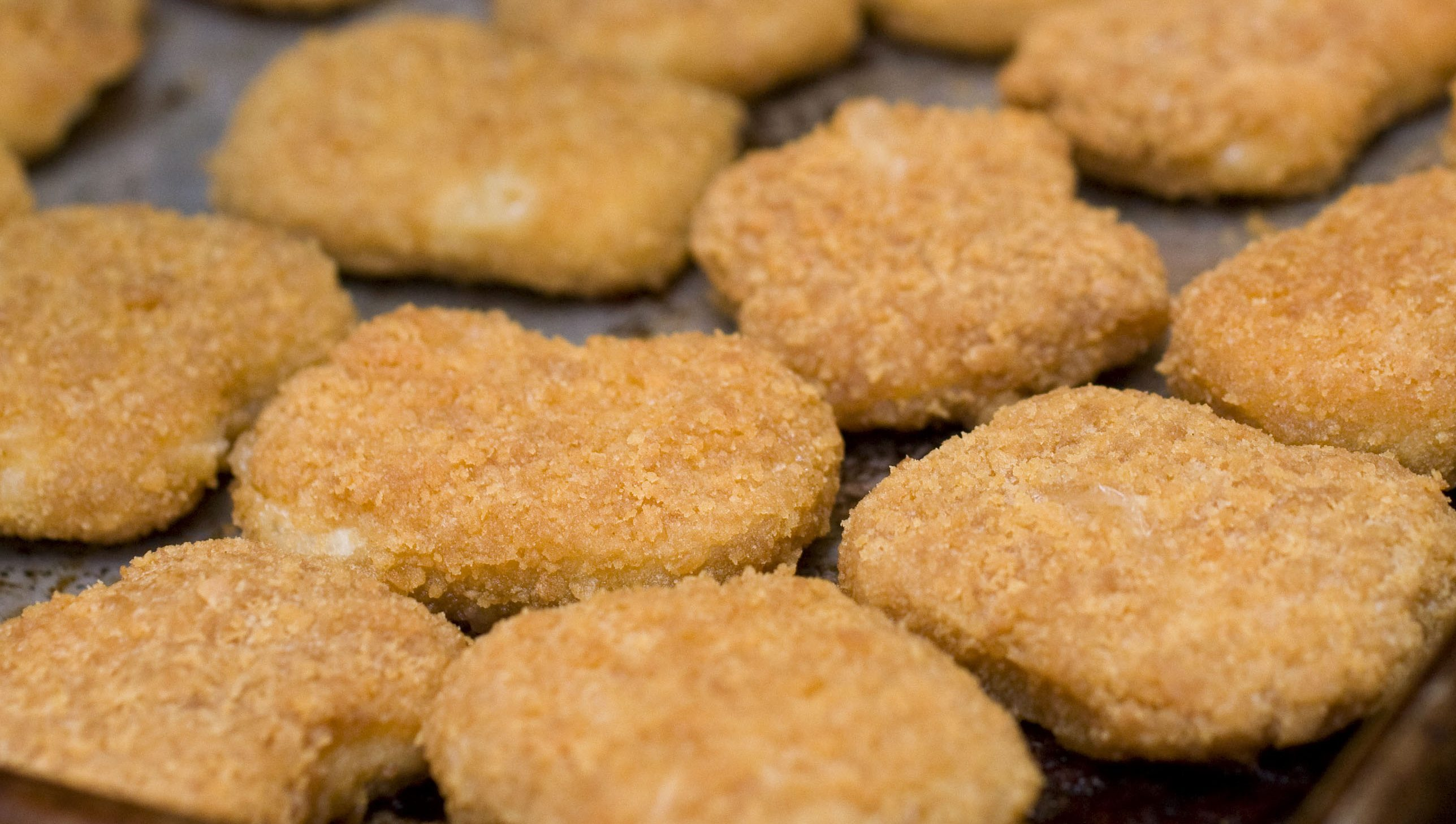 Chicken nuggets, fresh from the oven, are seen in this May 2, 2010 photo. Kids love chicken nuggets, but Consumer Reports says watch out for fat and salt.     (AP Photo/Larry Crowe)