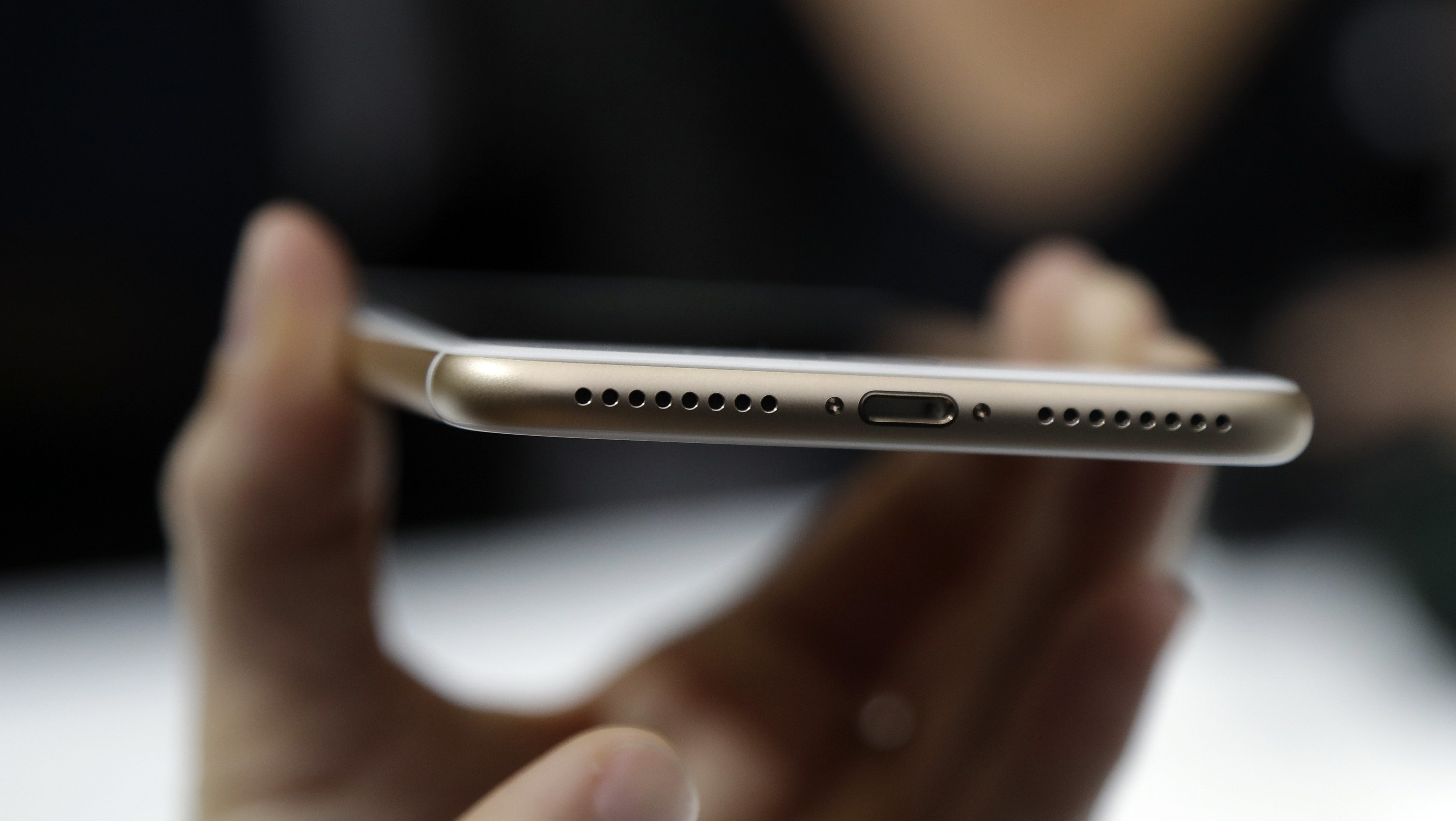 In this Wednesday, Sept. 7, 2016, photo, the lightning port of an iPhone 7 is shown during an event to announce new Apple products, in San Francisco. The new iPhones are better, even when considering that the most dramatic change is what got taken away: the traditional headphone jack. Without a traditional headphone jack, wired headphones plug into the Lightning port normally used for charging. (AP Photo/Marcio Jose Sanchez)