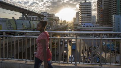 A woman walks on bridge to a station of the city's light railway, in Addis Ababa, Ethiopia Monday, Oct. 10, 2016. Ethiopia's government on Monday blamed Egypt for supporting outlawed rebels and forcing the declaration of the country's first state of emergency in a quarter-century as widespread anti-government protests continue, though Egypt last week denied any support for the Ethiopian rebels.