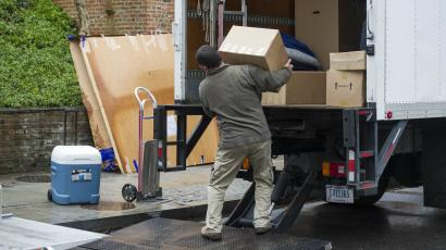 Movers taking boxes out of a truck