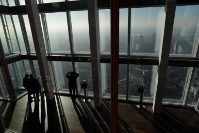 People look out window from London's tallest building
