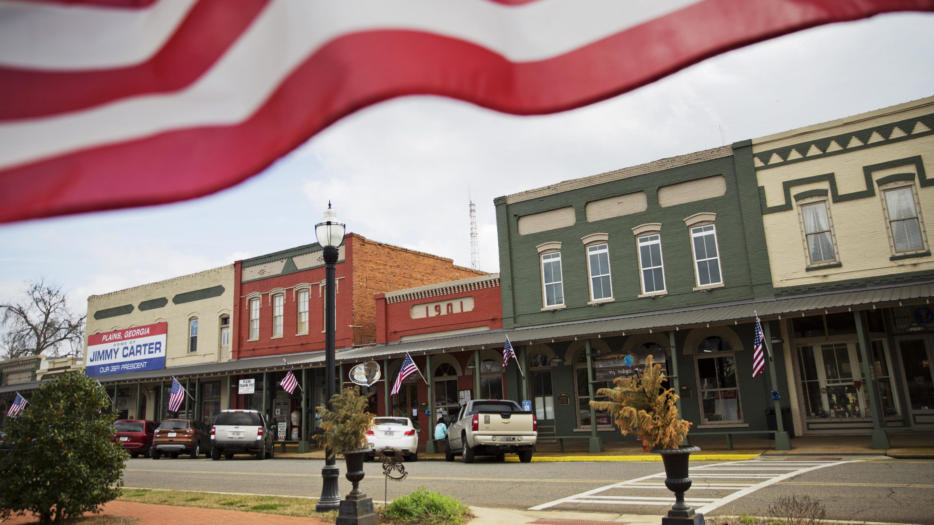 american flag over small town