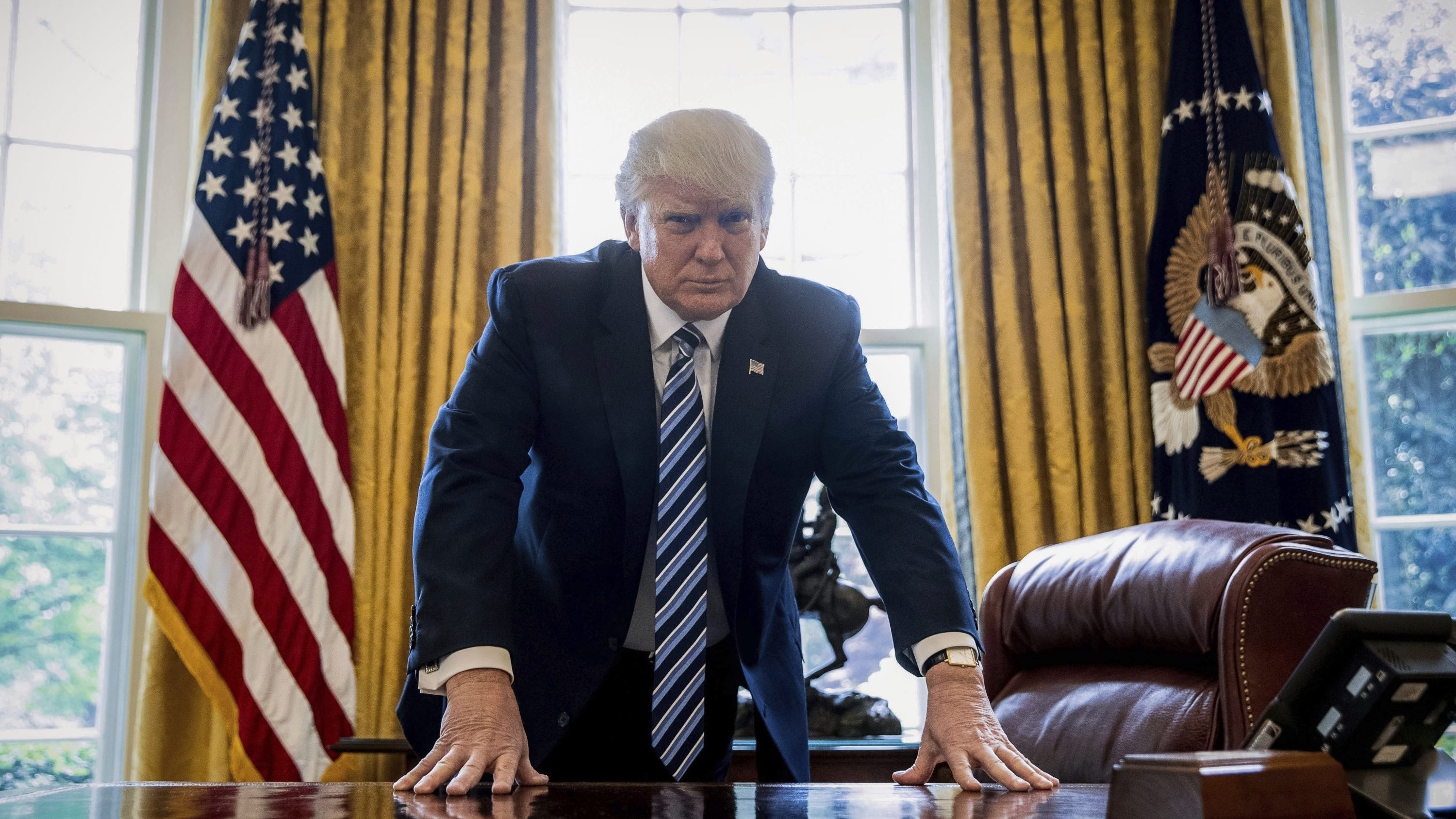 DAY 92 - In this April 21, 2017, file photo, President Donald Trump poses for a portrait in the Oval Office in Washington after an interview with The Associated Press.