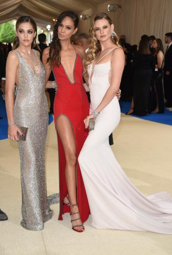 Sistine Rose Stallone, from left, Joan Smalls and Behati Prinslooand attend The Metropolitan Museum of Art's Costume Institute benefit gala celebrating the opening of the Rei Kawakubo/Comme des Garçons: Art of the In-Between exhibition on Monday, May 1, 2017, in New York. (Photo by Evan Agostini/Invision/AP)