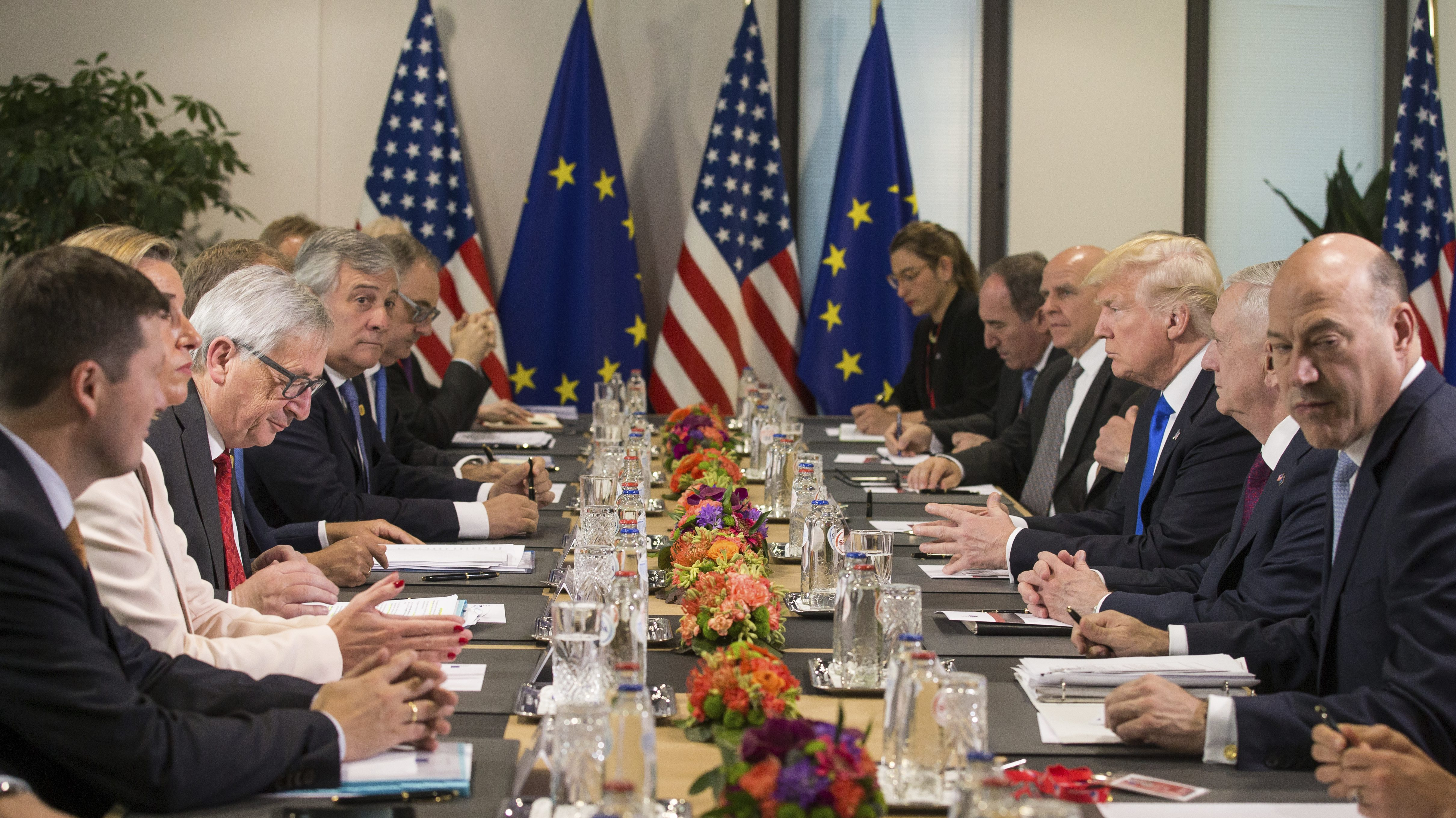 US President Donald Trump, 3rd right,   US Defense Secretary, James Mattis, 2nd right, attend a meeting with EU leaders  Federica Mogherini, the EU High representative for foreign policy, partially seen 2nd left, EU Commission President Jean-Claude Juncker, 3rd left, along with other officials at the European Council, in Brussels, Belgium Thursday May 25, 2017.  US President Donald Trump arrived in Belgium Wednesday evening and will attend a NATO summit as well as meet EU and Belgian officials.   (Stephanie Lecocq/Pool via AP)