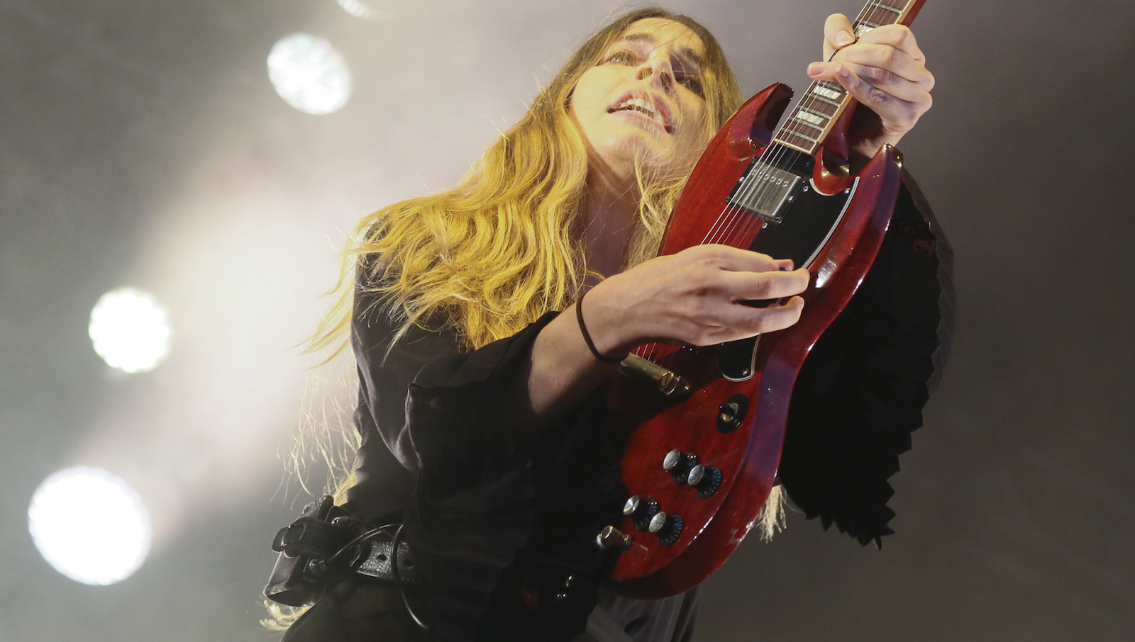 HAIM's Danielle Haim performs on the third day of the Austin City Limits Music Festival on Sunday, Oct. 2, 2016, in Austin, Texas. (Photo by Jack Plunkett/Invision/AP)