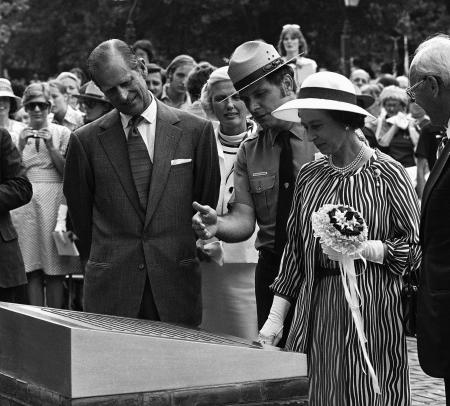 Hobart Gaywood, center, of the National Parks Service, shows a plaque describing the Bicentennial Bell, a gift of the Government of Great Britain to the United States, to Queen Elizabeth II and Prince Philip in Philadelphia on Tuesday, July 6, 1976. The Queen was here to present the bell and visited various points of interest in the area.