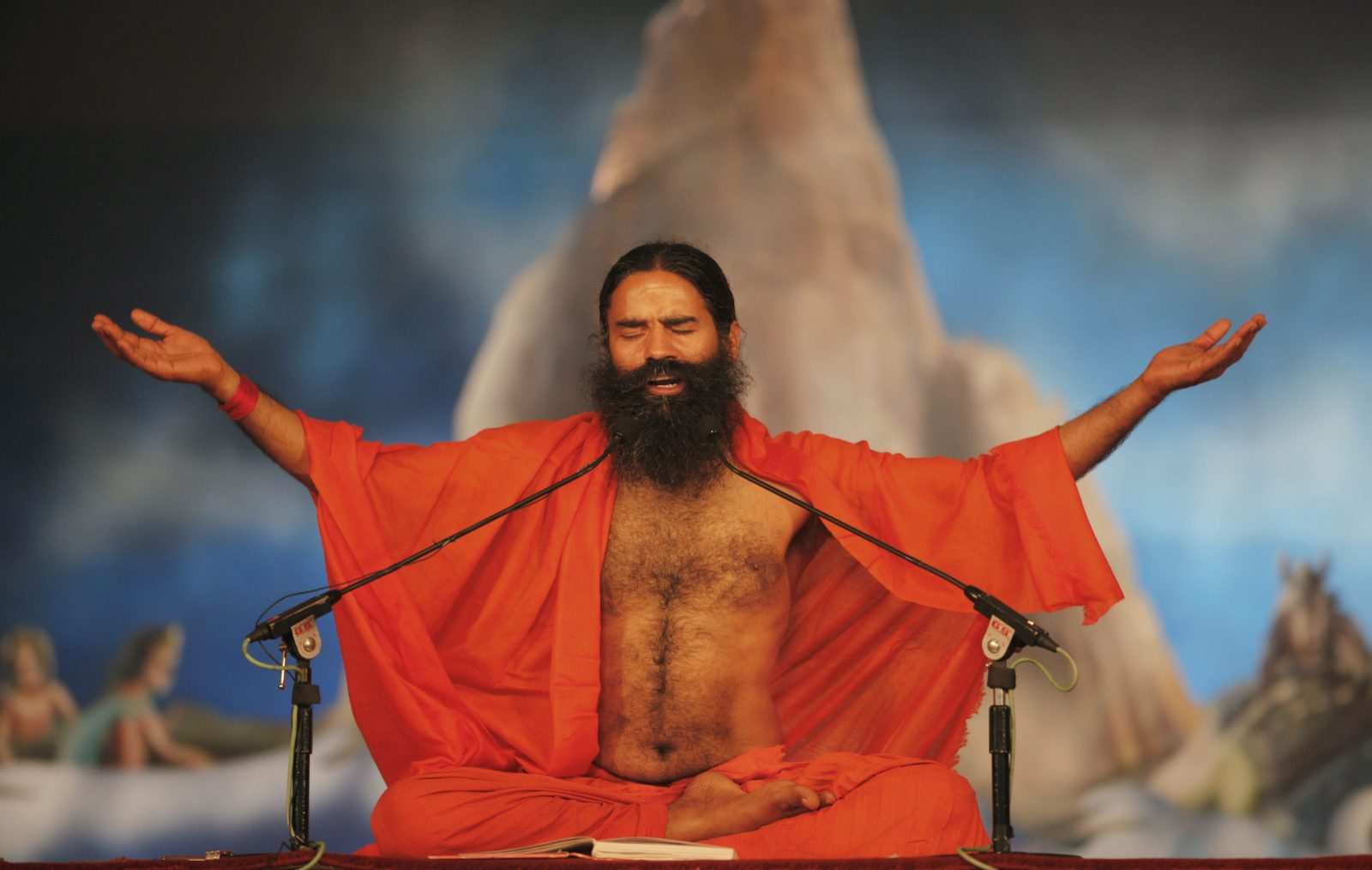 Indian yoga guru Baba Ramdev performs yoga at Sangam, the confluence of rivers Ganges, Yamuna and mythical Saraswati during the Maha Kumbh festival in Allahabad, Monday, Feb. 4, 2013. Millions of Hindu pilgrims are expected to attend the Maha Kumbh festival, which is one of the world's largest religious gatherings that lasts 55 days and falls every 12 years.