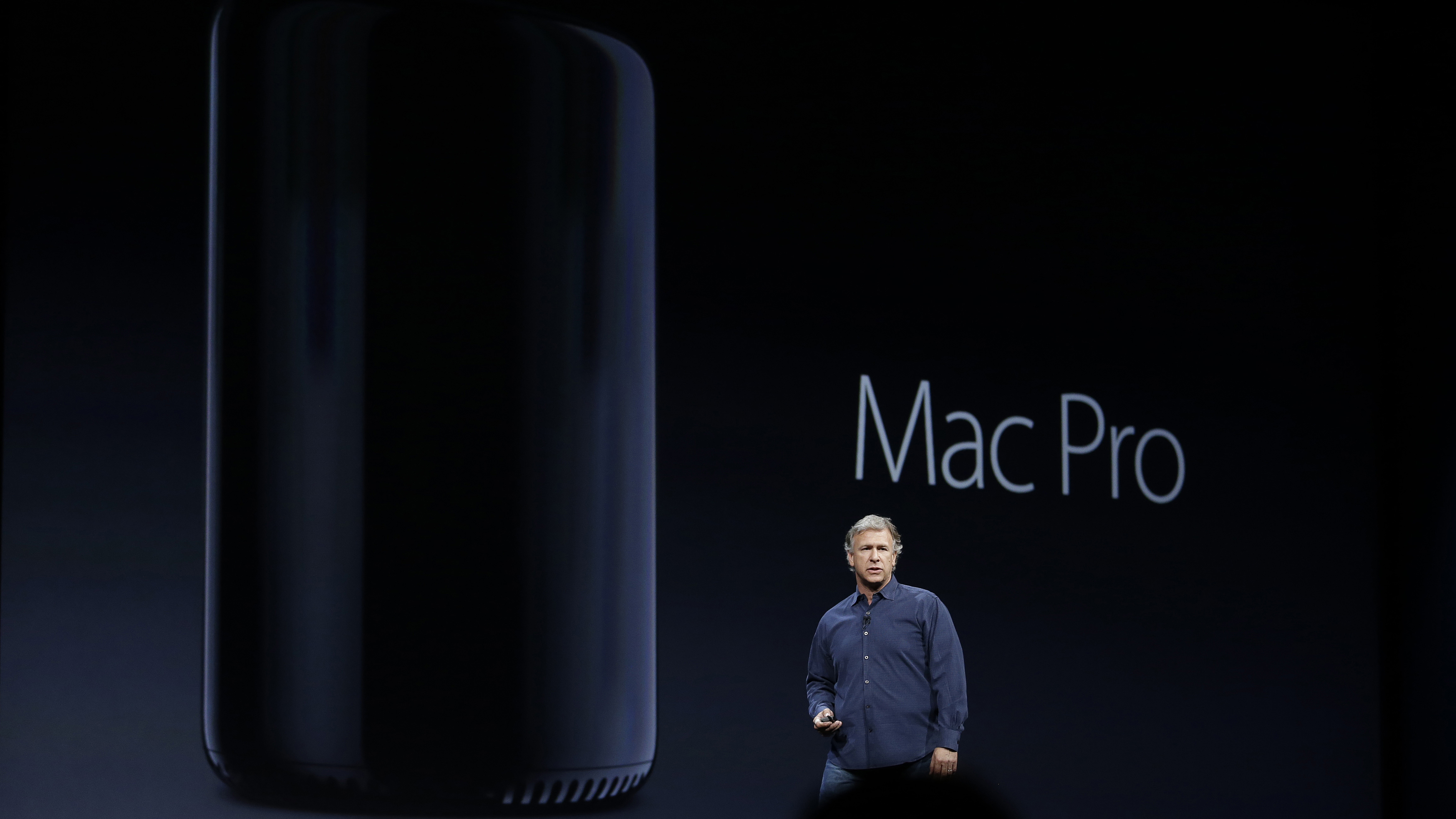 Phil Schiller the senior vice president of worldwide marketing at Apple talks about the new Mac Pro during the keynote address of the Apple Worldwide Developers Conference Monday, June 10, 2013 in San Francisco. (AP Photo/Eric Risberg)
