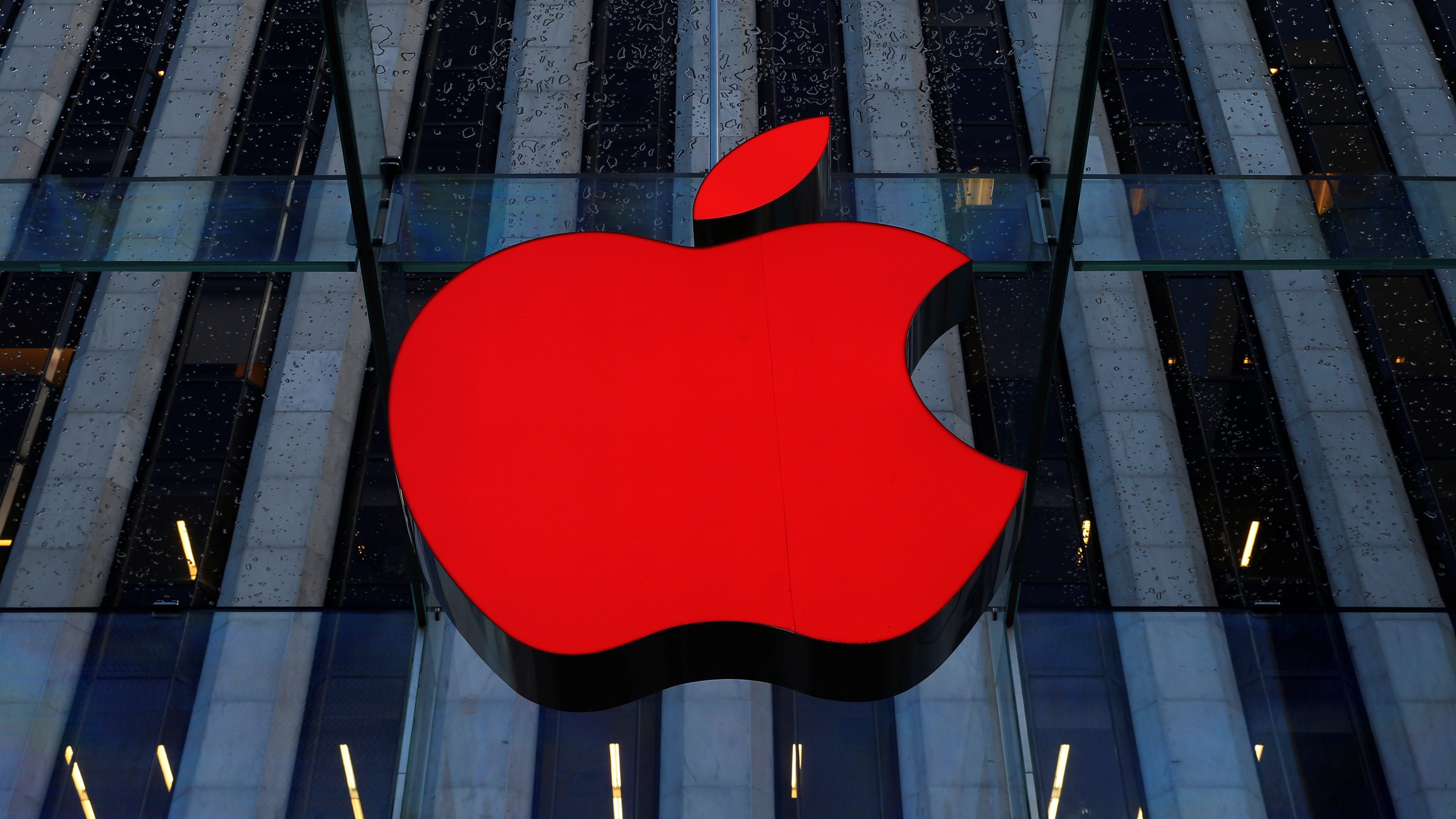 An Apple logo hangs above the entrance to the Apple store on 5th Avenue in the Manhattan borough of New York City, U.S., December 5, 2016.