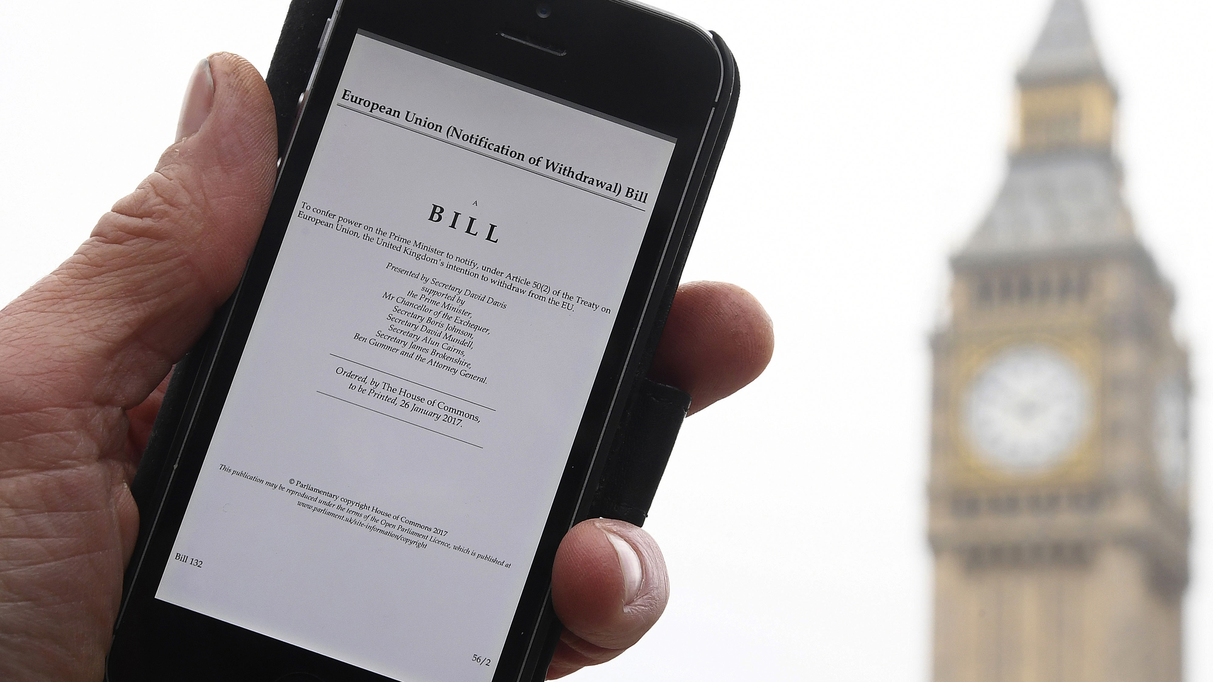 A man poses with an electronic copy of the Brexit Article 50  bill, introduced by the government to seek parliamentary approval to start the process of leaving the European Union, in front of the Houses of Parliament in London, Britain, January 26, 2017. REUTERS/Toby Melville - RTSXHJ2