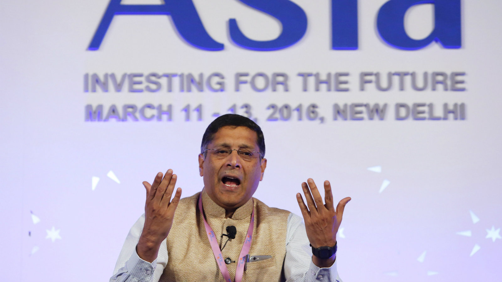 "Arvind Subramanian, chief economic adviser at India's Finance Ministry, gestures as he speaks during a session themed Asian Growth Models at the ""Advancing Asia: Investing for the Future"" conference in New Delhi, India, March 12, 2016."