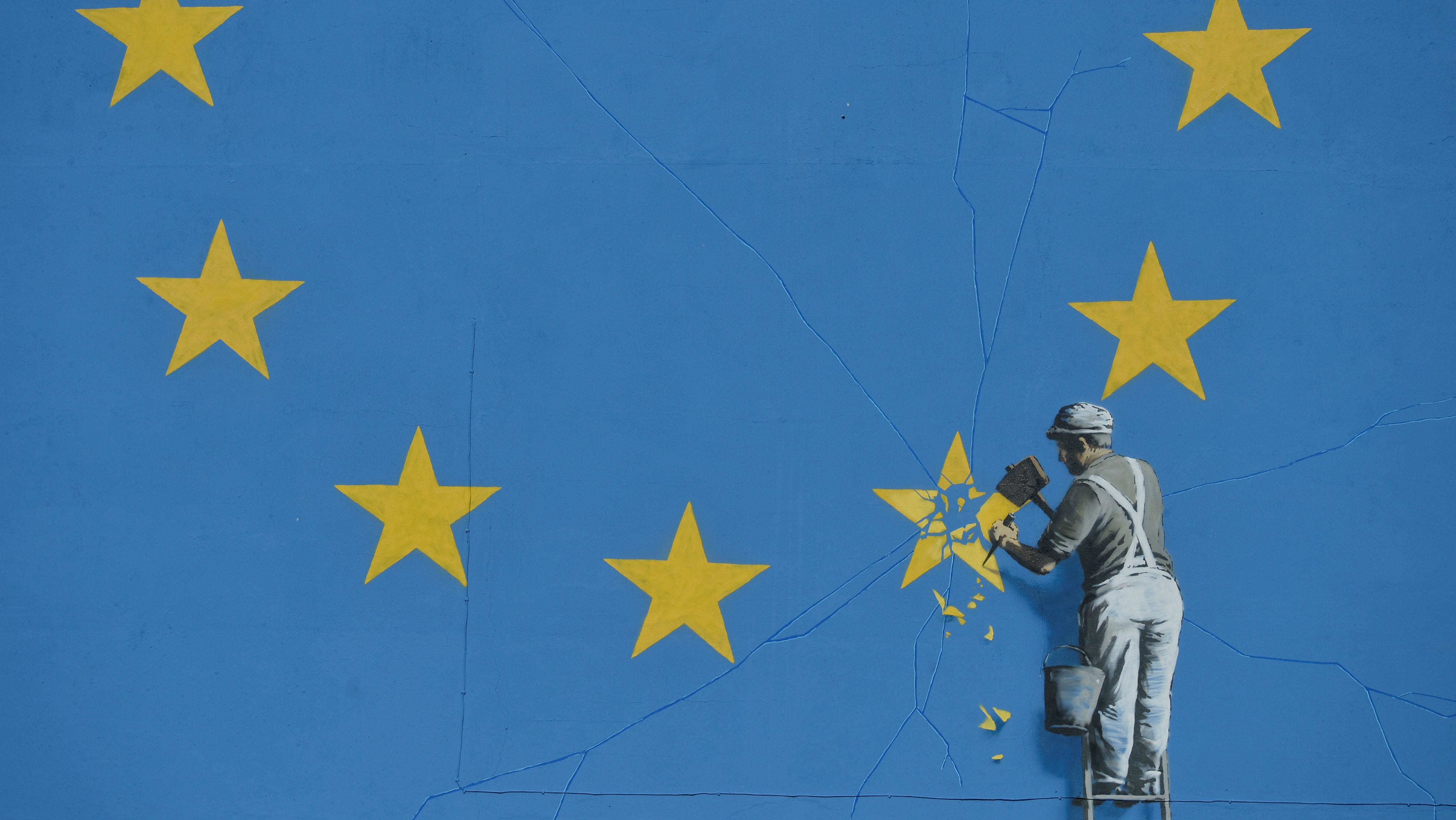 Banksy artwork in Dover depicting a workman chipping away at one of the 12 stars on the flag of the European Union